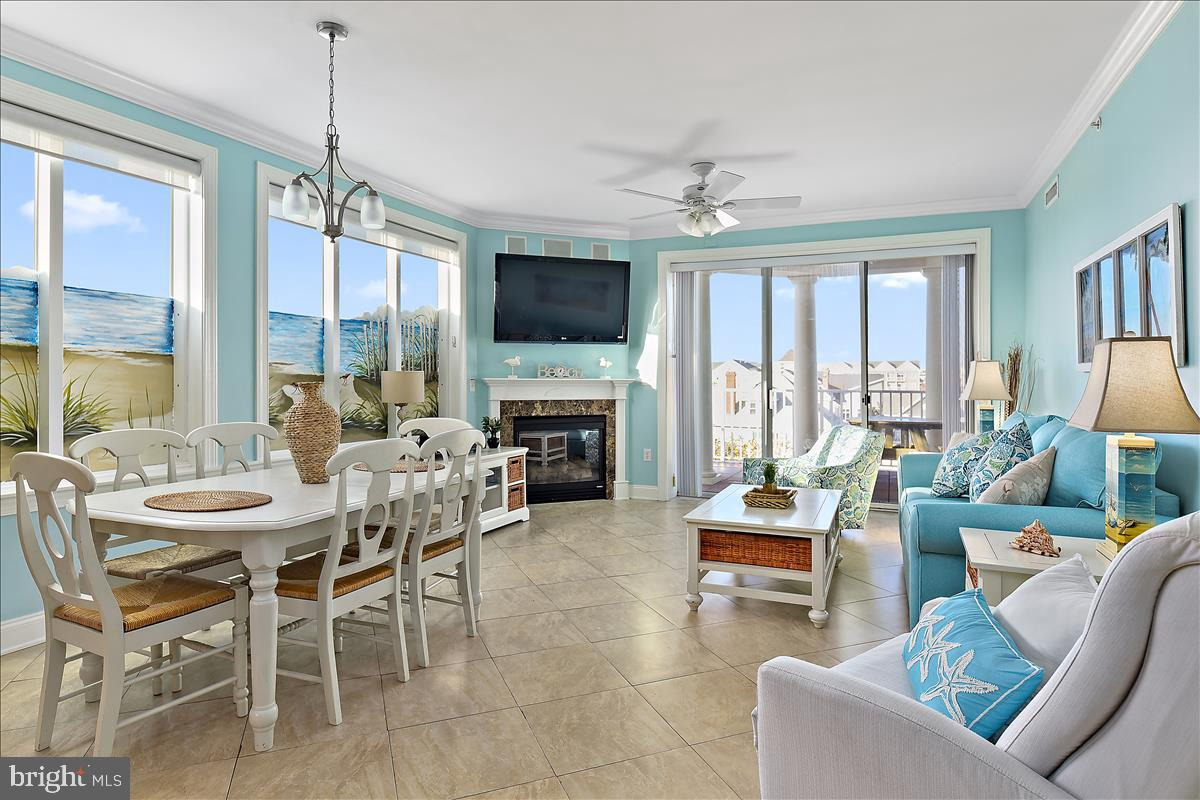 Price Improvement on this gem of a unit. Direct Beach and Boardwalk location. WHAT ARE you waiting for imagine yourself owning this luxury condo enjoying the sounds of the ocean, smelling the salt air and Fisher's popcorn from your sun- filled balcony? Beautiful corner condo with breathtaking bay and ocean views. This meticulously maintained unit offers 3 bedroom 2.5 baths, gourmet kitchen, stainless steel appliances, surround sound throughout, crown molding in every room, wainscoting and balcony access from all bedrooms. Two assigned parking spots in a secured covered garage, private storage unit, fitness center, sauna, putting green, rooftop pool, a sundeck with incredible views of Assateague and the Ocean City pier. The Belmont is just steps away from many famous attractions; ocean, beach,  boardwalk, pier rides and endless amusements for everyone. Keep this beauty for yourself or take advantage of the easy rental income that this popular boardwalk building generates. RARE Opportunity to purchase two units side by side with massive adjoining balcony's.  #411 and $409 both for sale. If purchased together can generate over $120k of rental income per season. Comes fully furnished with brand new sleeper sofa and living room chairs.