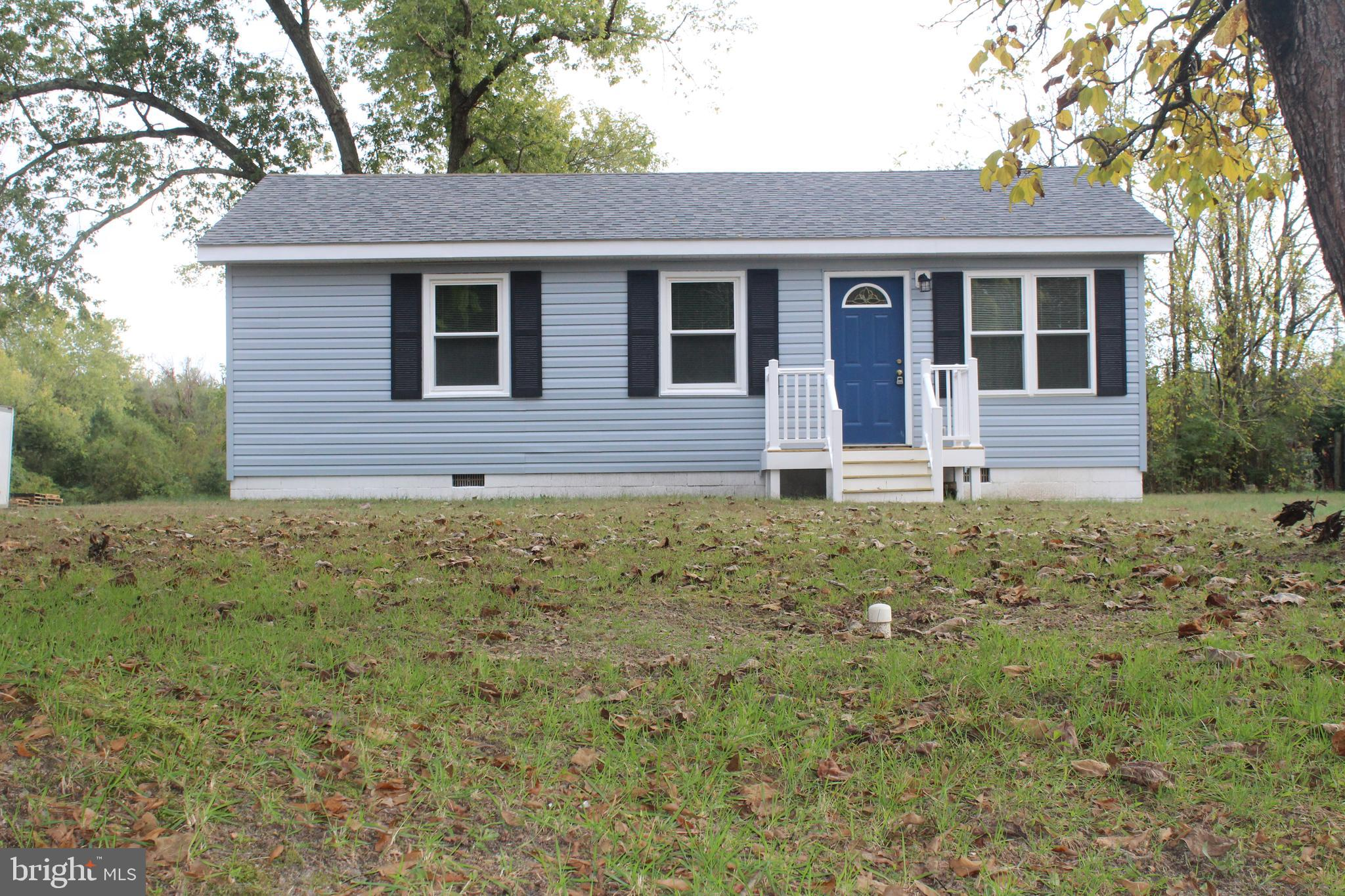 Completely renovated rancher on 2 acres of land. Fresh paint, new carpet in bedrooms, new flooring t