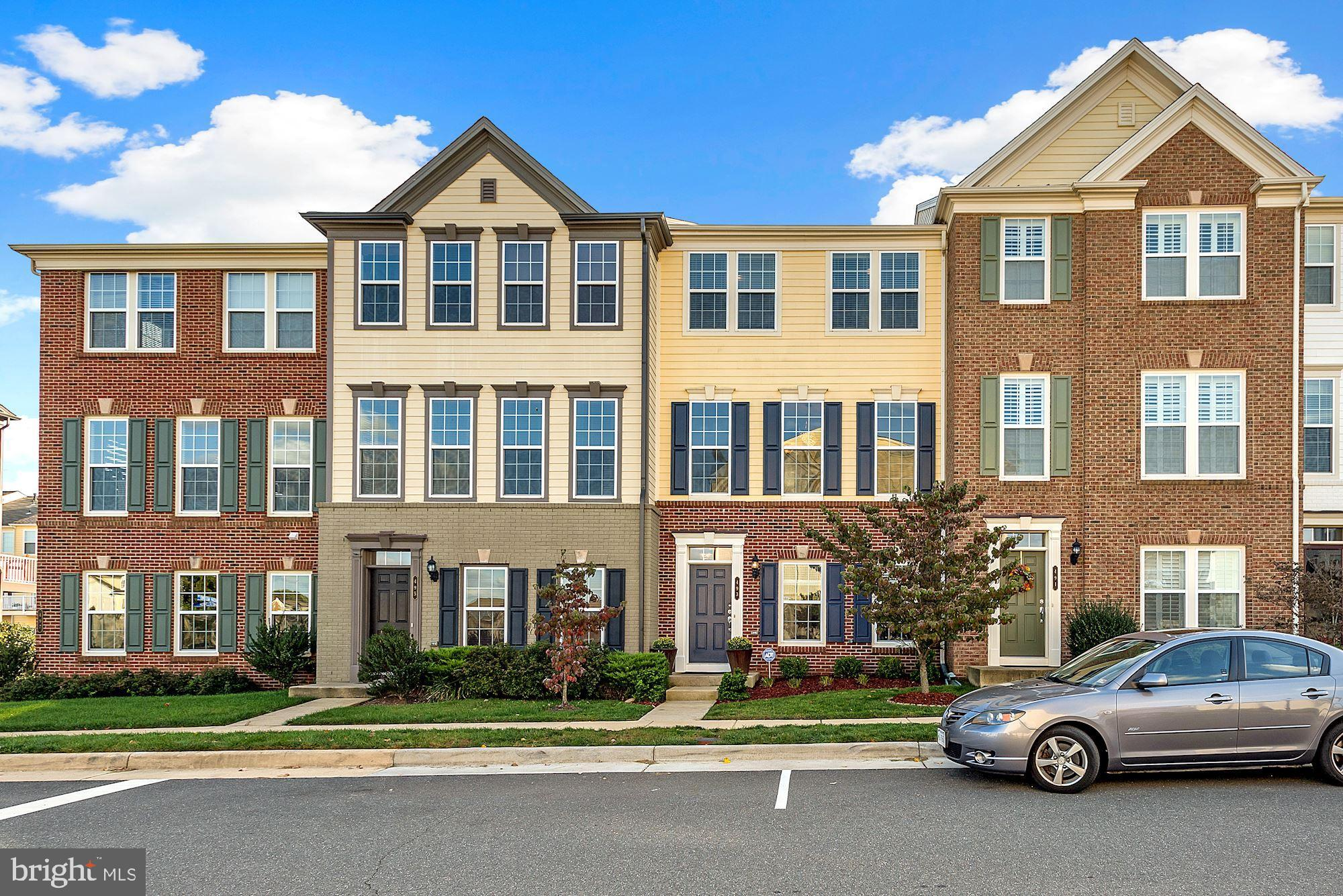 Gorgeous 3 level townhome w/detached 2 car garage & storage in the Oaklawn Townhouse Community.  The