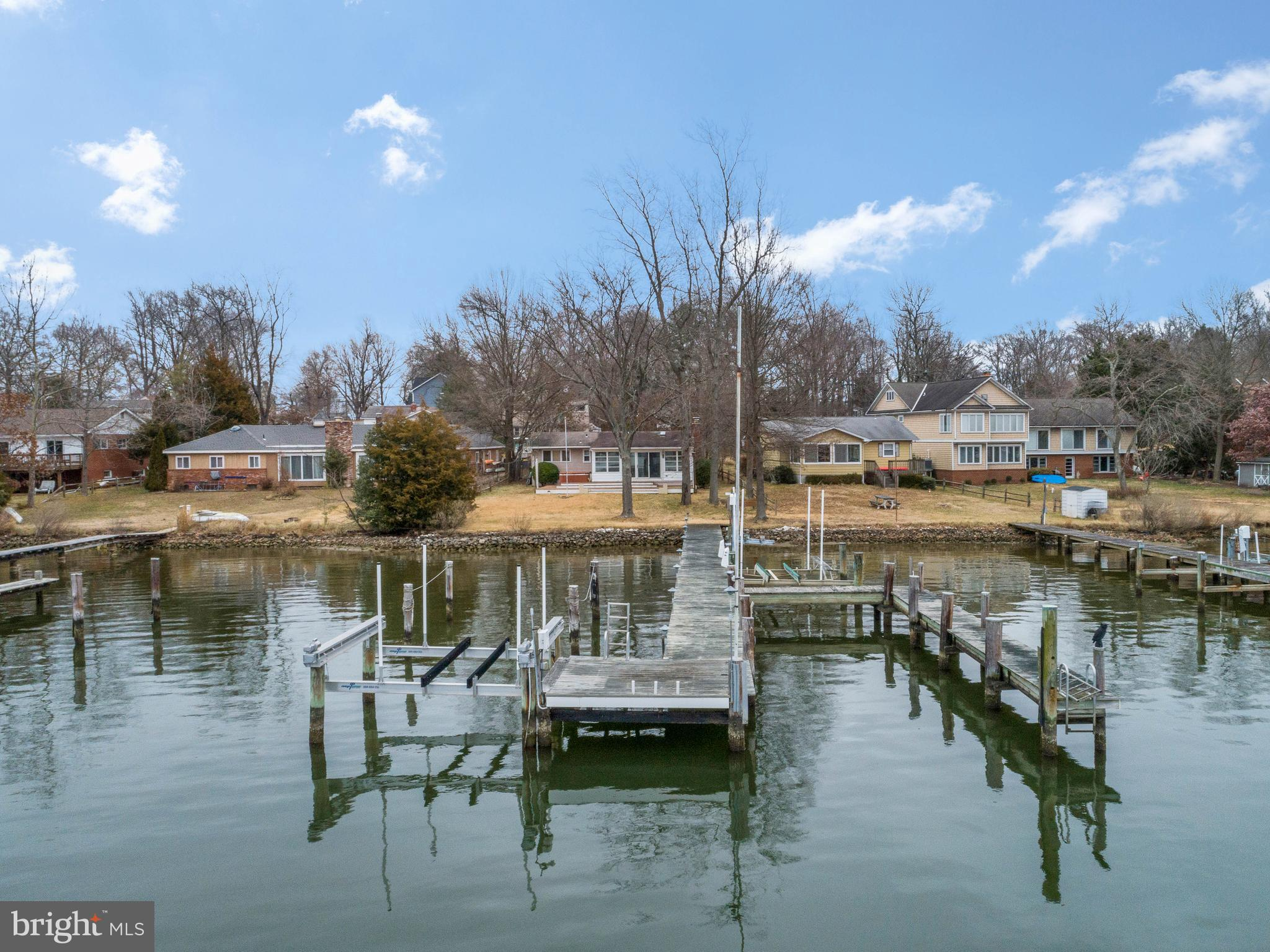 WATERFRONT in Loch Haven!  Here's your opportunity to vacation where you live!  Beautiful views of Brewer Creek and beyond to the South River.  Deep water at the private pier that can accommodate your sailboat, power boat or other water toys.     Just a quick ride on the boat out to the South River and Chesapeake Bay where you can enjoy fishing, water sports, cruising and waterfront restaurants.  One level cottage with loads of natural light.  Nice flat lot, sun room, family room with fireplace, kitchen with space for your table, 3 bedrooms, 3.5 bath, a large 2 car garage and shed for extra storage.  Community amenities help make this neighborhood so beloved -  including community marina, beach with swimming nets, boat ramp, kayak racks,  playground, basketball and tennis courts.  Great opportunity to update the current house, renovate to your liking or build new.   Sought after neighborhood, great water and blue ribbon schools! Come make this your new home!
