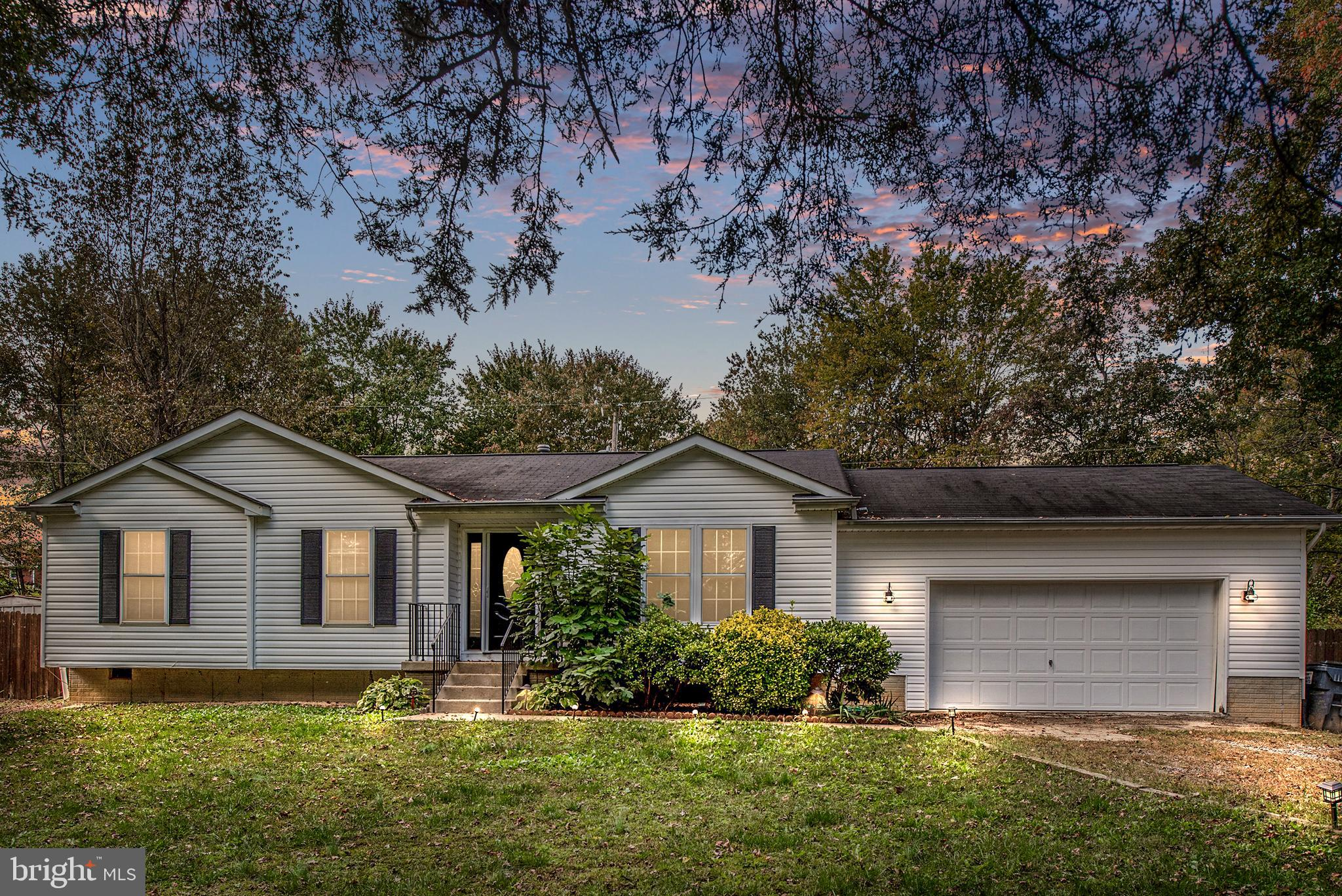 Charming 3 bedroom Ranch in Grafton Village on almost an acre! Oversized garage with a full bathroom