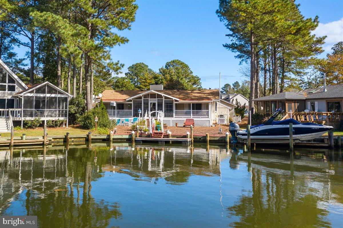 Professional Photos will be uploaded Shortly .........Waterfront Home Ocean Pines! Large corner lot,