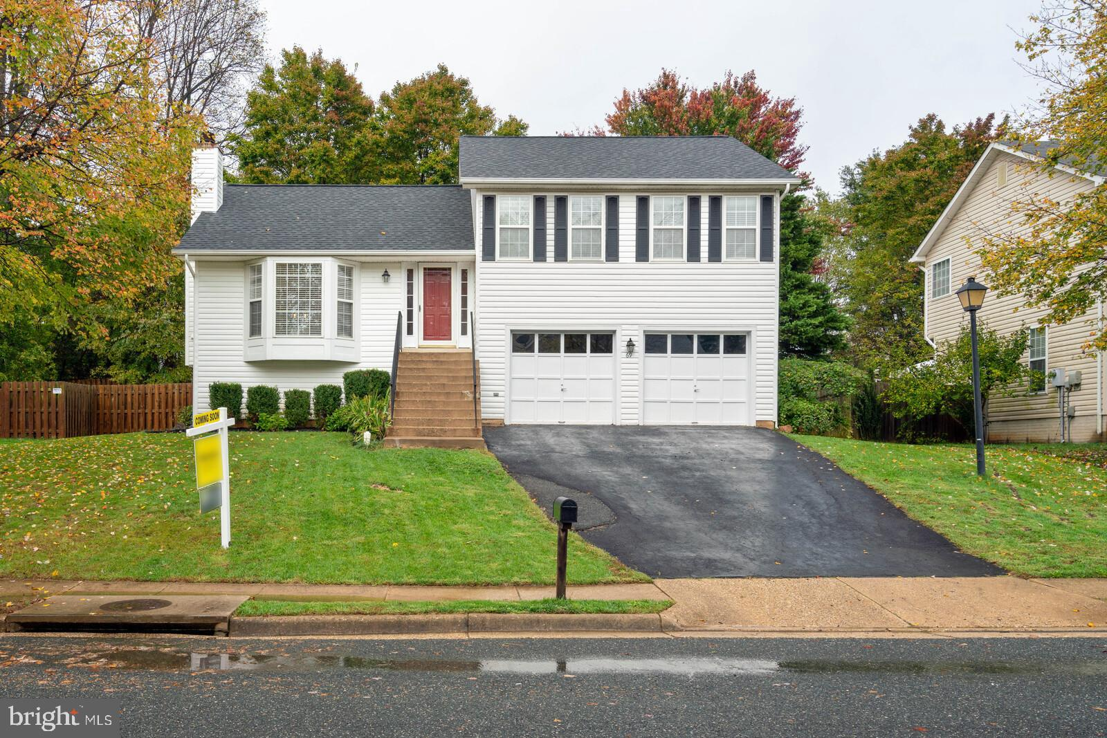 A 4-level home with new paint throughout the home, replacement roof/gutters with guards (2017),  hot