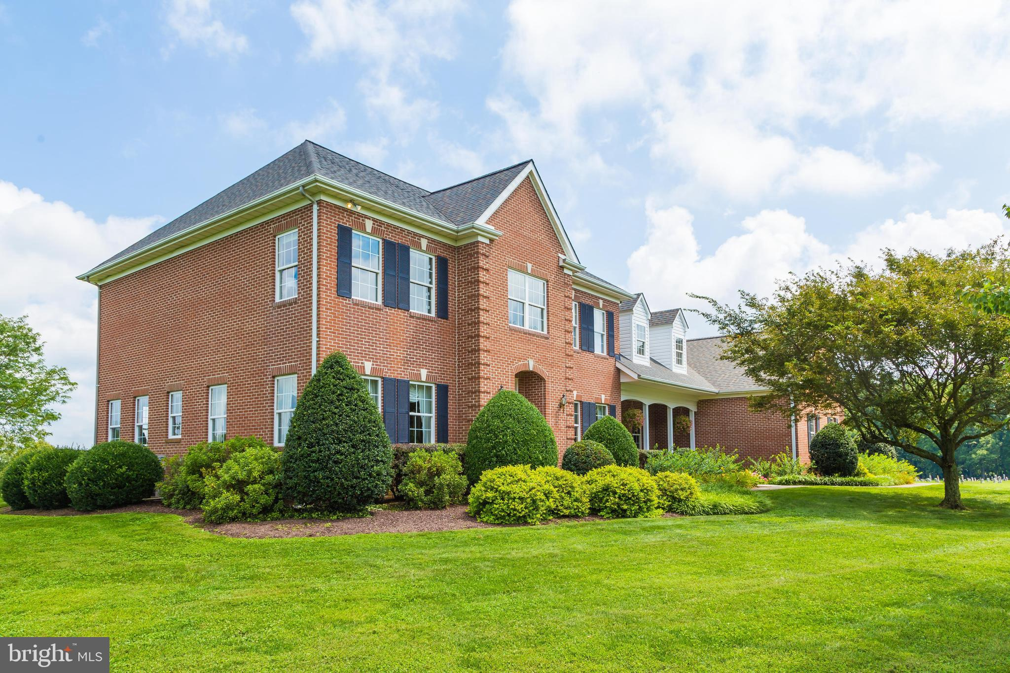 All Brick Custom Built Colonial Home on an Amazing piece of property with a 3 Car Garage!  This home