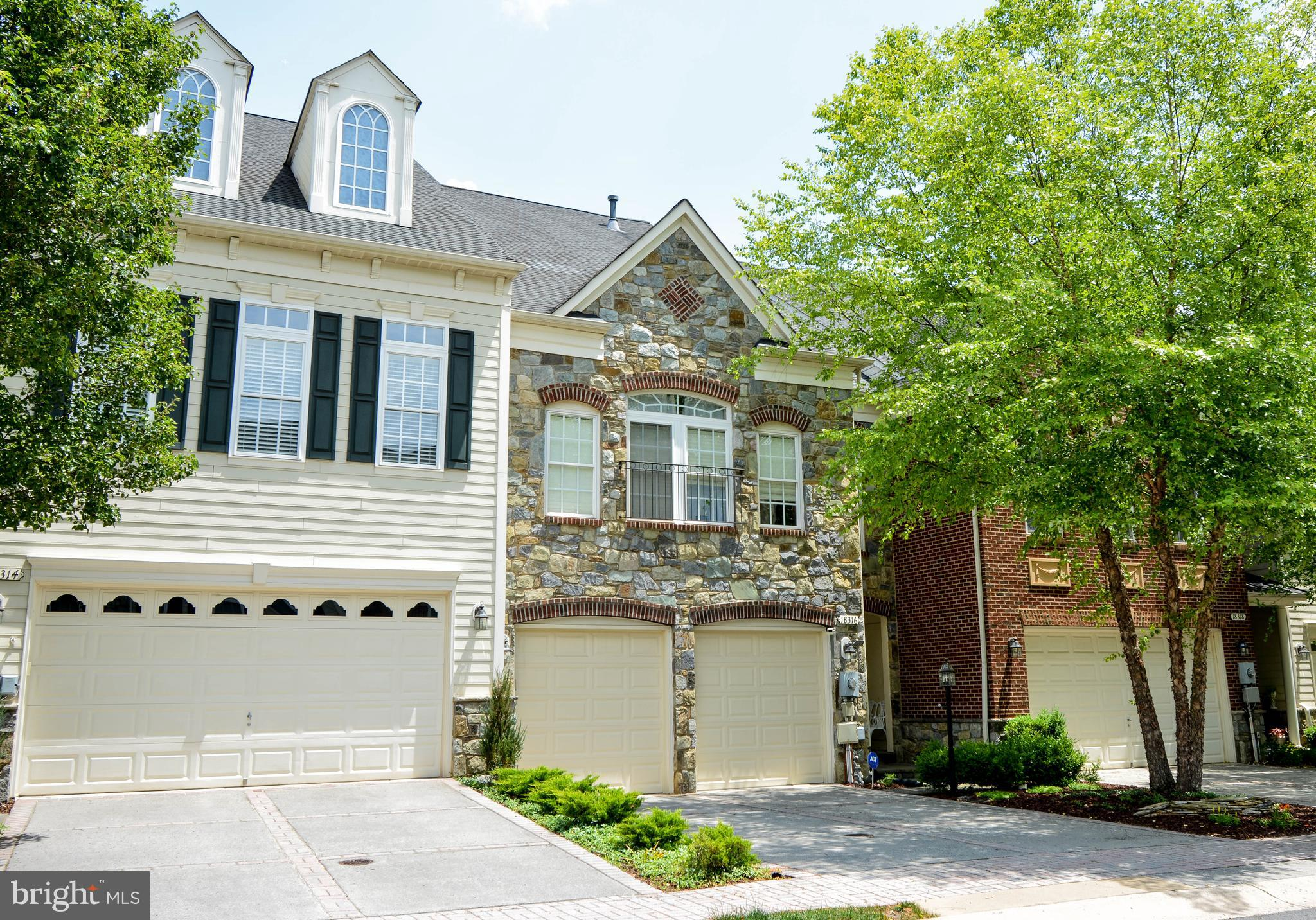ABSOLUTELY STUNNING, LUXURY 4 LEVEL STONE TOWNHOME WITH SEASONAL POTOMAC VIEWS LOCATED IN RIVER CREE