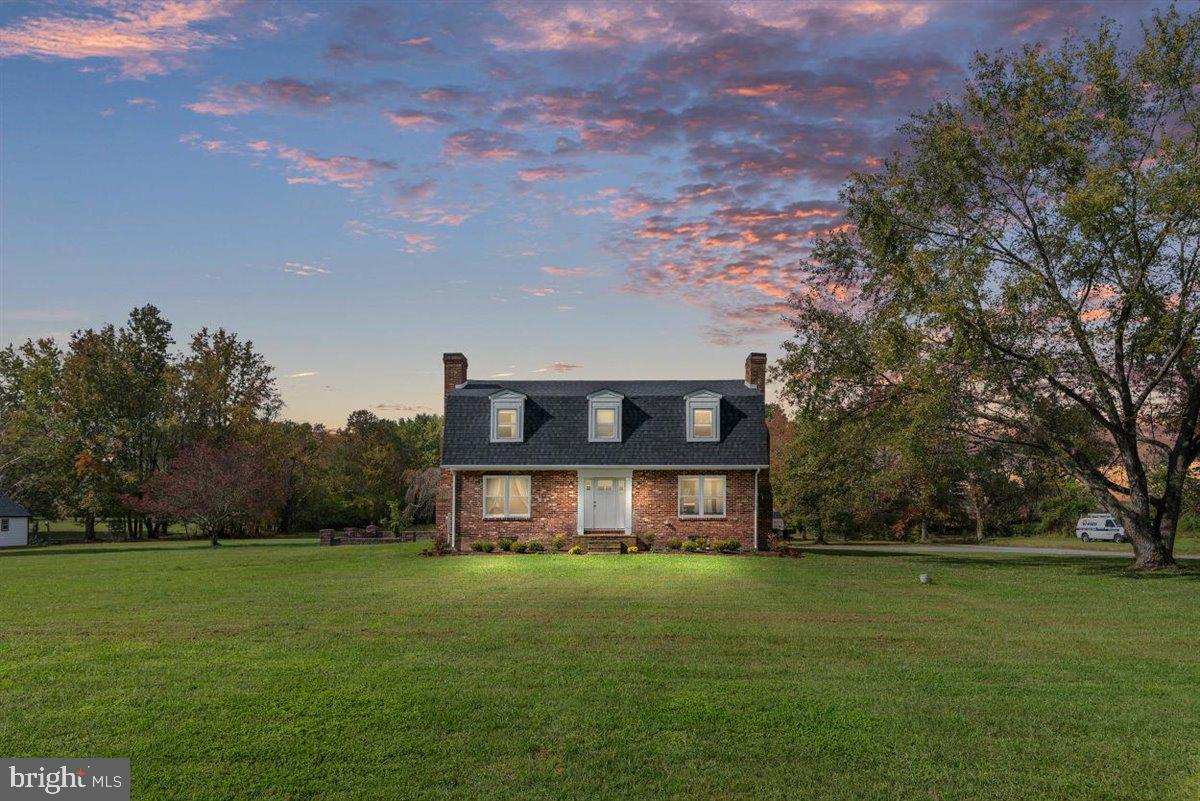 This spectacular all-brick home has it all. Featuring a coveted location just outside of Centreville
