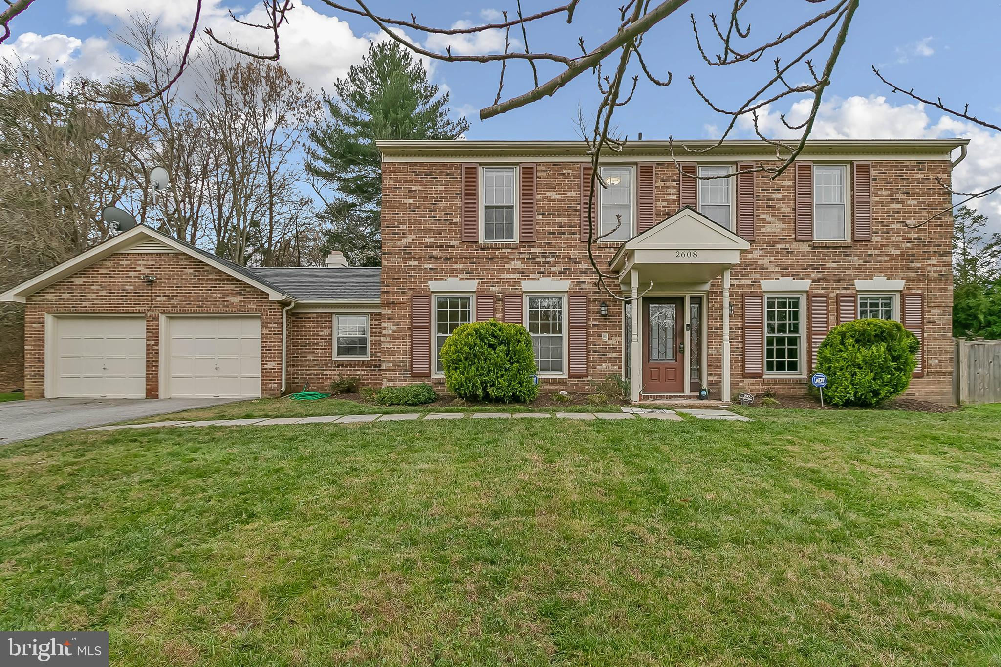 Brick front Colonial freshly painted throughout features 4 bedrooms 2 1/2 bath with a first level de