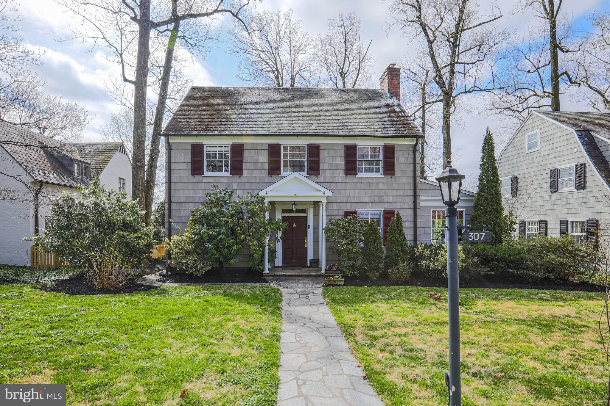 Just reduced! Gorgeous English style colonial  set back on a quiet side street of historic Homeland.    This light filled  5  bedroom, 3.5 bath has been tastefully updated throughout while keeping all of the charm of it's era.  Hardwood floors,  newer appliances, granite counters, open living room  with fireplace and  adjoining sunroom, large  dining room,  newly renovated  master and hall baths, custom barn doors and  closet in master, central air,  and  new flooring in the basement.   3rd floor has 2 rooms and a full bath perfect for guests, a  yoga room  and /or office.  The finished basement has an open area and a utility room with plenty of storage  plus new washer and  dryer.  One of the best backyards in the neighborhood- a fenced in yard,  delightful  garden and stone patio perfect for relaxing or entertaining.   Enjoy the beautiful ponds and scenic paths a few blocks away.   A list of all updates is in the documents section. Click for virtual tour at top of listing.  A must see!