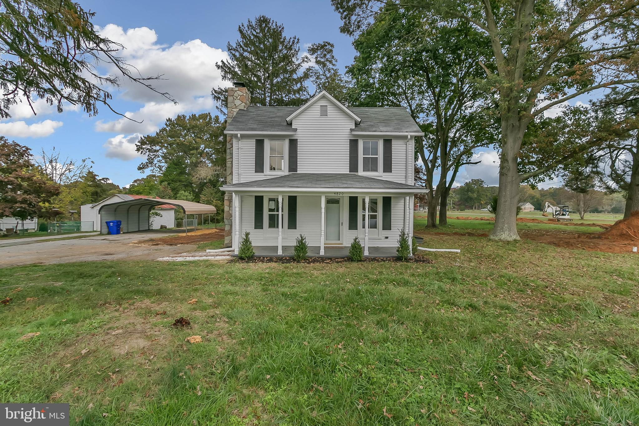BEAUTIFUL TWO STORY FARM HOUSE ON LARGE 2 ACRE LOT... Main level features custom kitchen, granite co