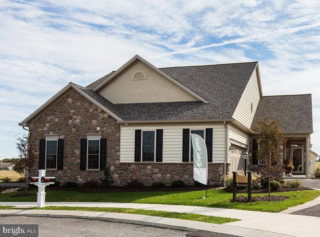 BLACK FRIDAY SALE !  DISCOUNTED $25,000 FOR THIS EVENT ! Available now and move in ready!  This BRAND NEW Wisteria Grande cottage has been designed with you in mind.  It has almost 2500 sq . ft. of living space.  The main floor has luxury vinyl plank throughout and has 2 bedrooms, 2 full baths, a desirable open floor plan with a kitchen, dining and great room  all adjacent to each other which makes for a great entertaining space.  This home also has a sun room which can be used as another living area, home office, breakfast room,  etc.  The kitchen has upgraded cabinetry,  a large pantry , granite countertops, tile backsplash, 60 inch island, and a  stainless steel appliance package with a gas stove . The great room has a gas fireplace with slate surround . This home also has a 2nd floor with a loft, 3rd bedroom and a full bath, a great space for guests .  There is no shortage of storage in this home as it has a full unfinished basement with 9ft ceilings. Come see why so many people are choosing Honeycroft Village .  The community continues to grow and has wonderful amenities including a clubhouse with an indoor heated pool & spa,  a state of the art fitness center,  community gathering rooms, outdoor patios, raised bed community gardens, bocce ball court , plus much more.  Sales Center  is open Fridays, Saturdays & Sundays 1-4 pm other days and times by appointment .