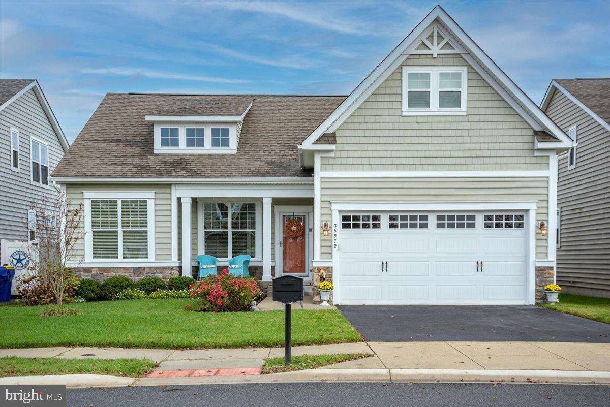 Enjoy casually elegant living close to Bethany Beach in this 4 Bedroom, 3 Bath home with 2-car garag