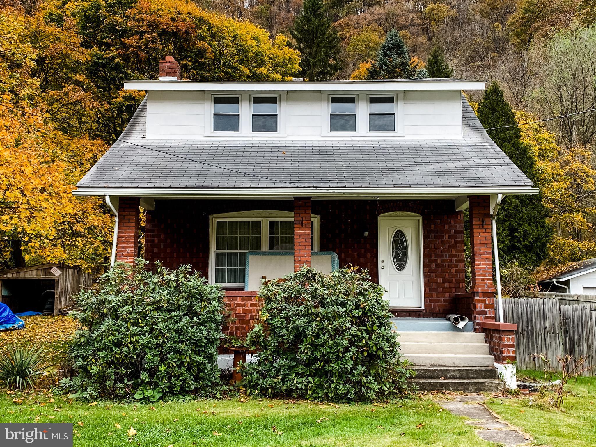 Wow! Don't miss this ADORABLE LaVale home! Huge (1 Acre) lot, 2 cozy porches, convenient location, a