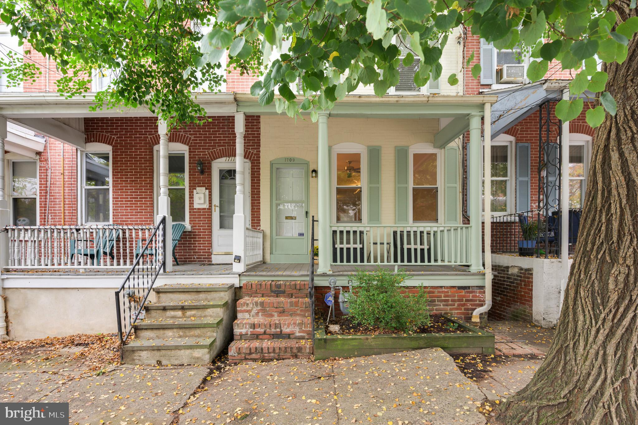 Charming Trolley Square townhome situated on a quiet, tree-lined street located steps from all the a
