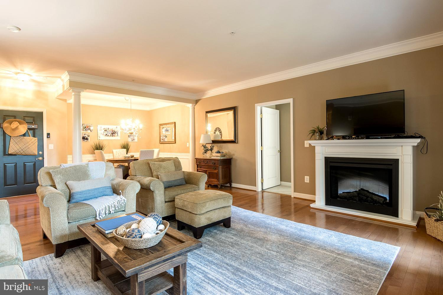 COVETED AMENITY RICH ANNAPOLIS CONDO in gated, active-adult FOUR SEASONS AT ST. MARGARETS! Healthy living 55-PLUS COMMUNITY with organized & singular activity clubhouse, pool, fitness center & billiard/party rooms! Condo boasting over 1700 sq. ft. of single, ground level living space with alfresco dining patio & verdant lawn backing to trees. Open concept floor plan with abundant windows bathing rooms in light. Masterful detailing with column-framed Dining Room expanding into picture window Living Room with gas fireplace. Lustrous wood flooring, distinctive moldings & decorator neutral paint palette! French door spilling out to lounging & lunching patio. Stainless & granite Kitchen with computer/recipe workstation & window bay breakfast nook. Three breezy Bedrooms with NEW neutral carpeting. Two stylishly appointed Full Baths (one en suite). Parking pad & private 1-car garage with inside entrance. Conveniently located to shopping, restaurants, public library, walking trails and RTs 2/50/97! A YEAR-ROUND CHESAPEAKE BAY STAYCATION.