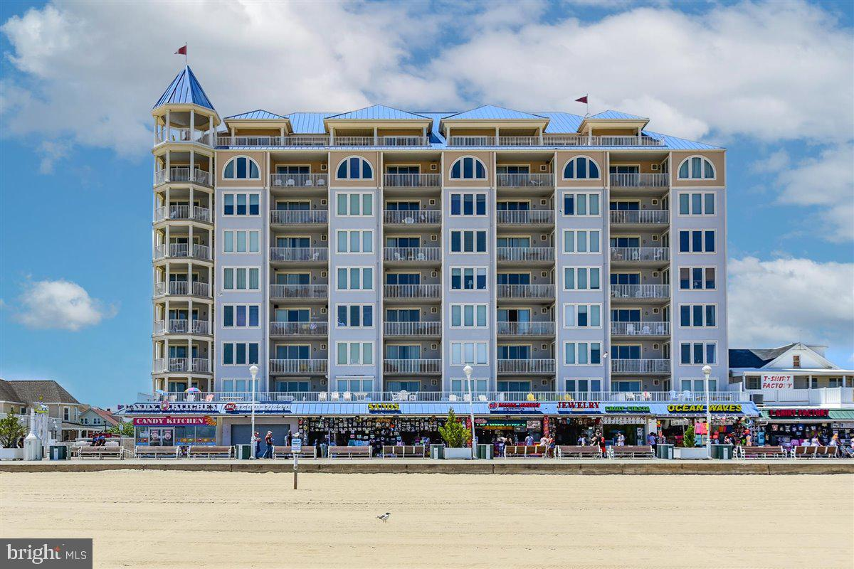 Great condo now available in one of Ocean City's best rental buildings!  Located in downtown Ocean City in an oceanfront and directly on the World Famous Ocean City Boardwalk building, this great 3 bedroom, 2 1/2 bath condo is just waiting for you!  Park your car in one of the two assigned spaces in the covered garage and never even think about your car until it is time to go home.  Hungry? Want to go to the beach or pool?  Want to shop or ride the rides?  All these things are just steps away!  Want to check out Assateague Island or America's Coolest Small Town, Berlin?  Just a short distance away for those as well!   Highly desirable building and fantastic investment opportunity!