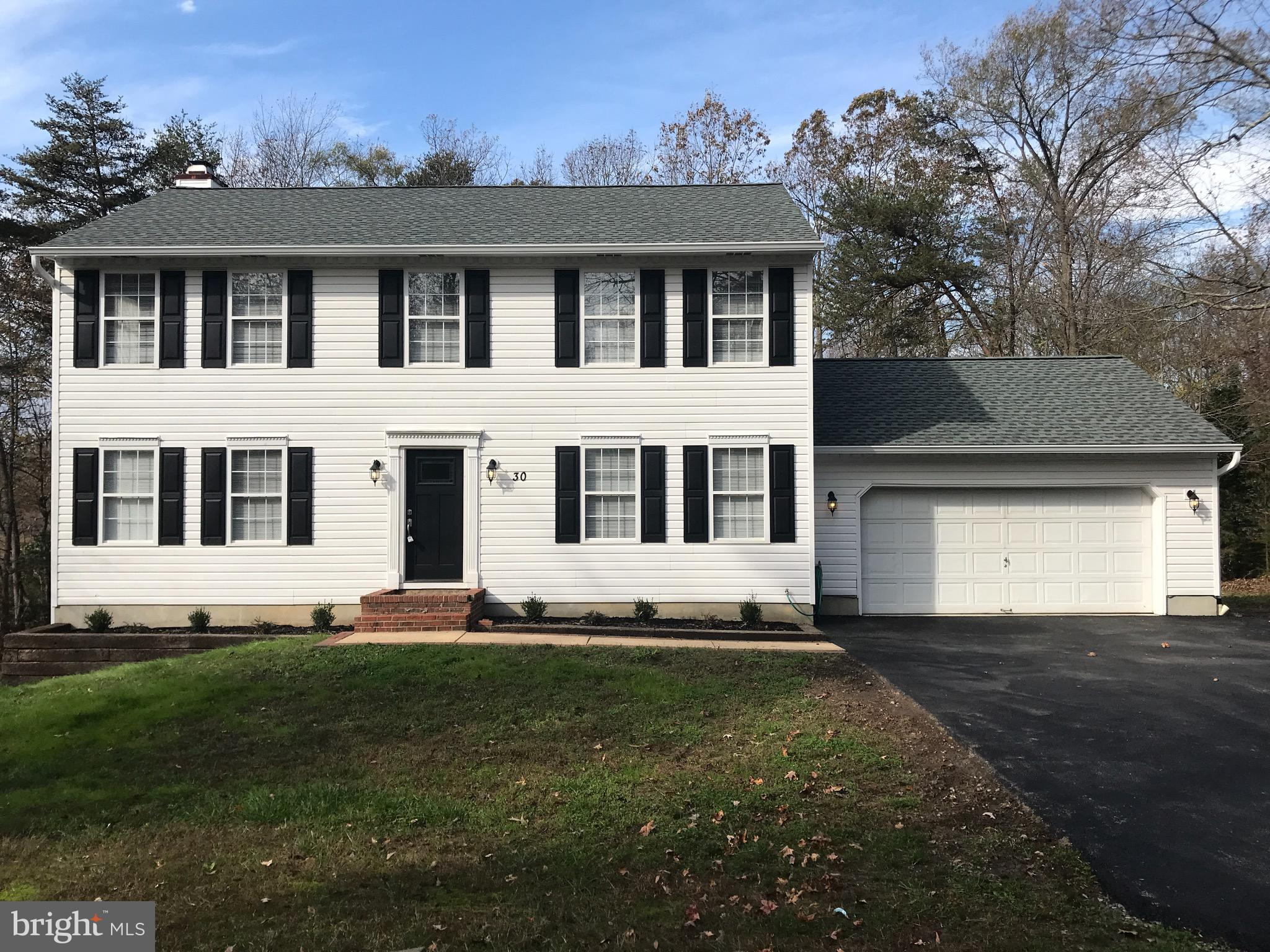 Beautiful Colonial!!!Total  Rehab!!! NEW HVAC, ROOF, PAVED DRIVEWAY !!! ALL NEW paint, flooring & ca
