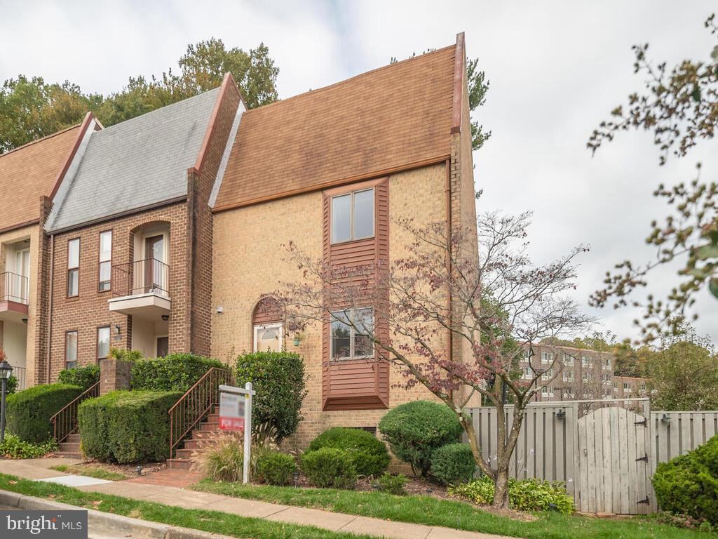 Rarely available Tysons Court end unit townhome.  Beautiful open floor plan with gleaming hardwood f