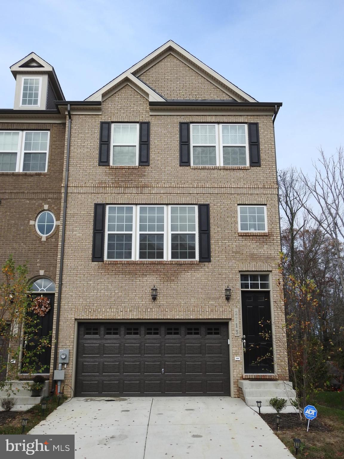 SHINES LIKE NEW! This multi-level Brick end Unit Townhome is a Rare find.  The 2-car front load gara