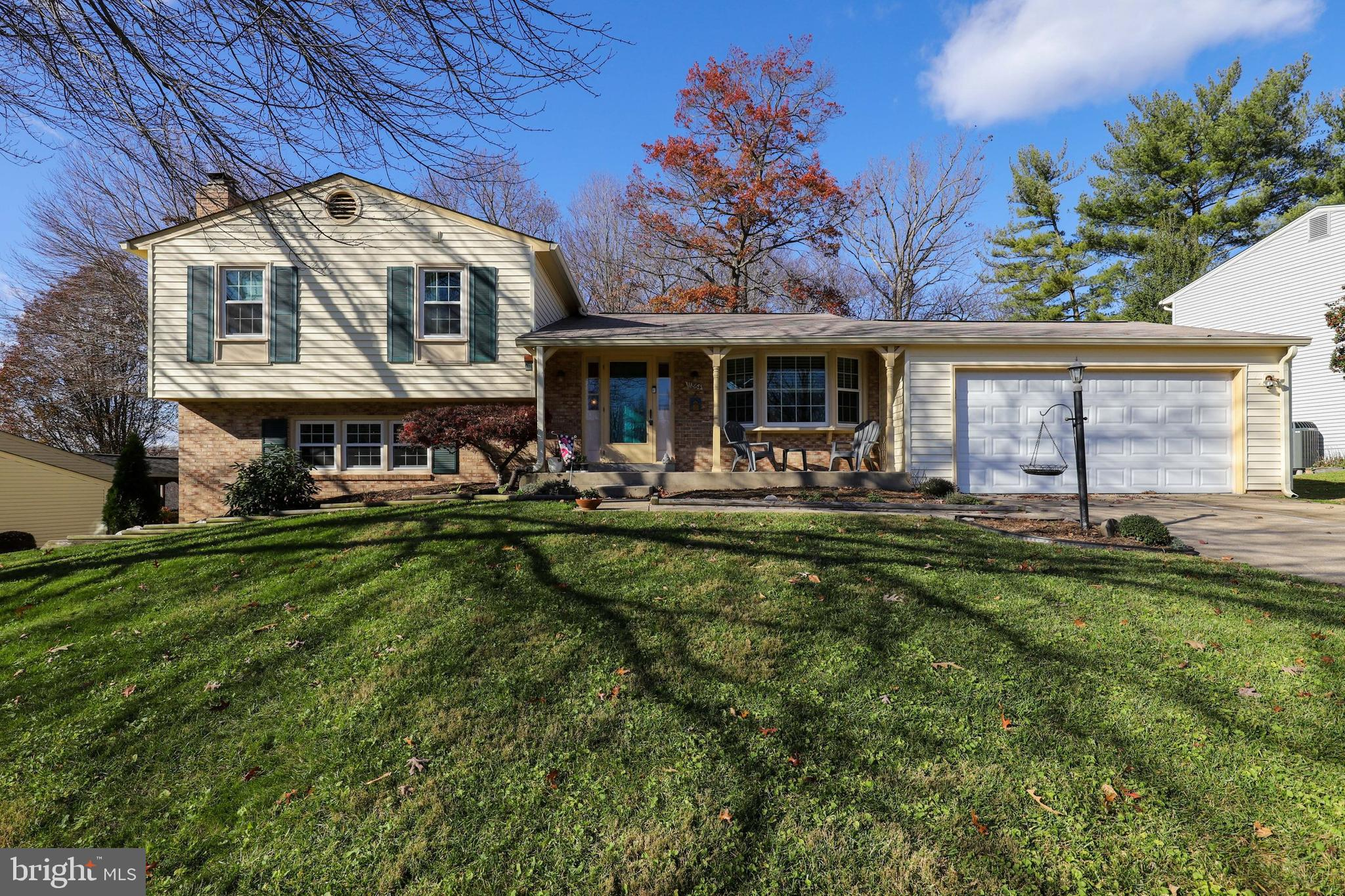 Beautifully maintained home nestled on quiet cul-de-sac welcomes you with impeccable landscaping and
