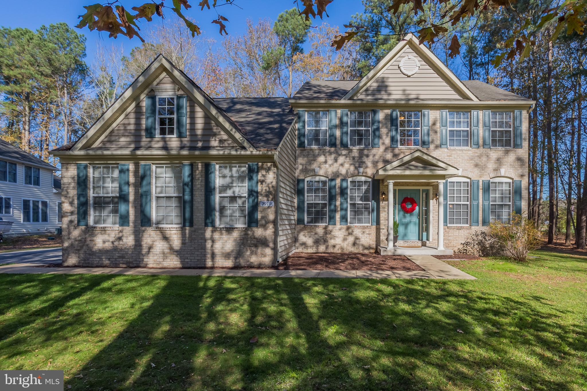 Nestled in Lakewood Estates II, a special piece of Sussex County! Situated on a partially wooded hom