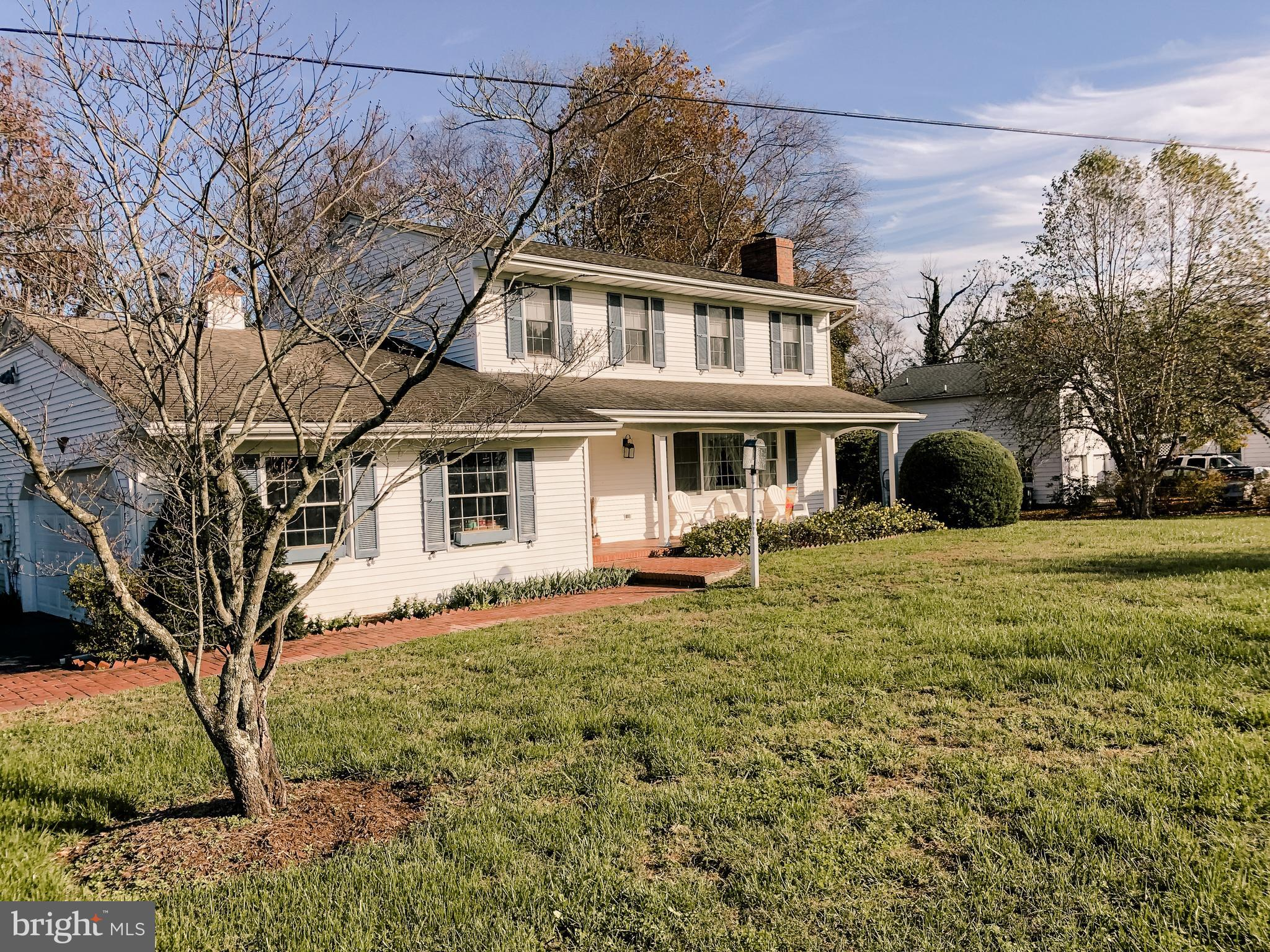 Stately 2 story colonial on a  level one acre lot in  the desired waterfront community of Breton Bay