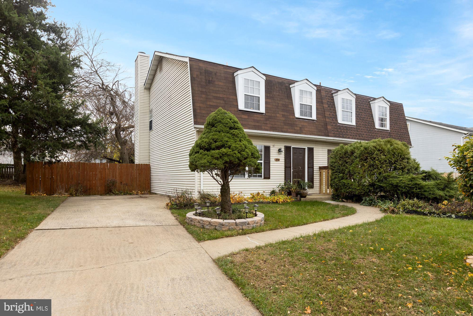 Two story duplex  well cared for by owners in quiet neighborhood so close to shopping, the Outlets a