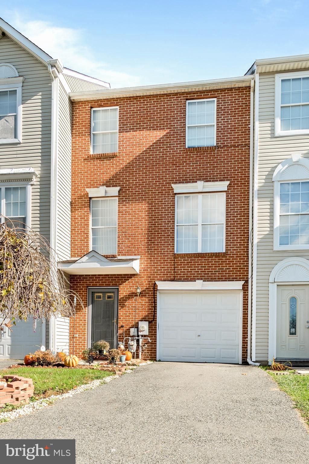 Welcome home to this brick front 2 bedroom, 2.5 bath townhome located in persimmons creek that backs