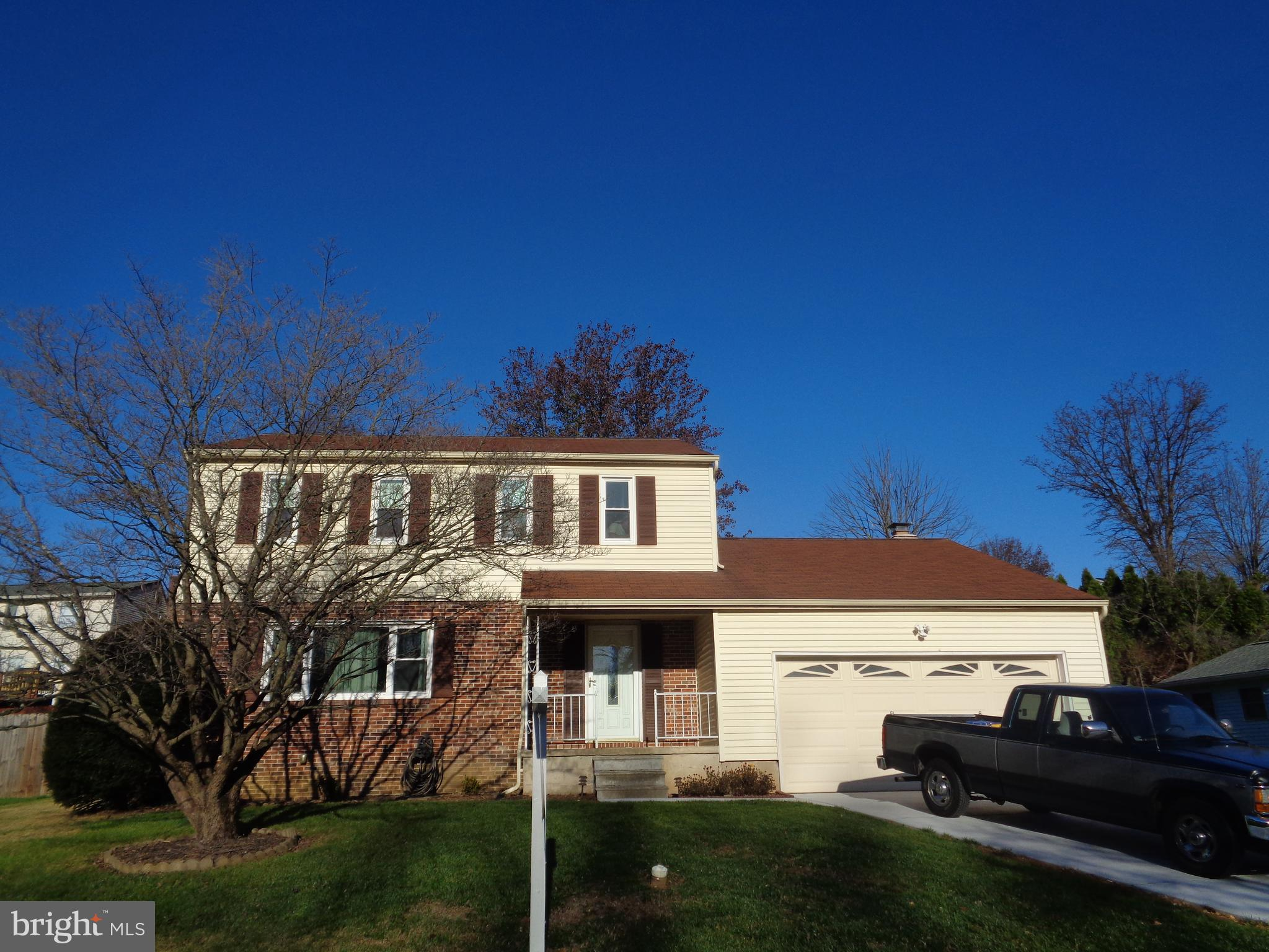 4 Bedroom 2-2 Bath Colonial with 2 car garage,  Updated Kitchen with Granite Counters and Stainless