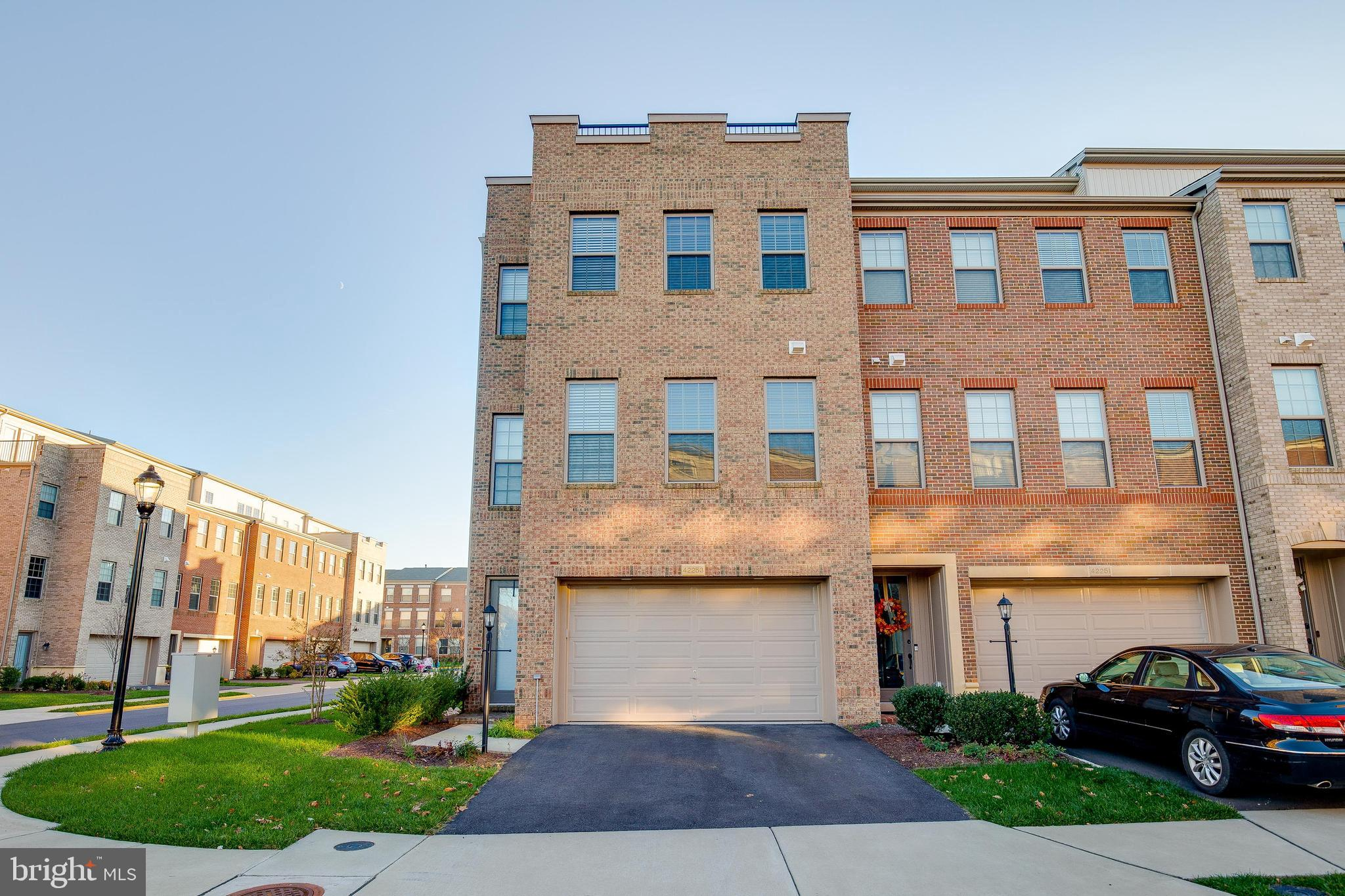 Stunning, 3 years young, light filled, end unit townhome in sought after Brambleton. Huge open floor