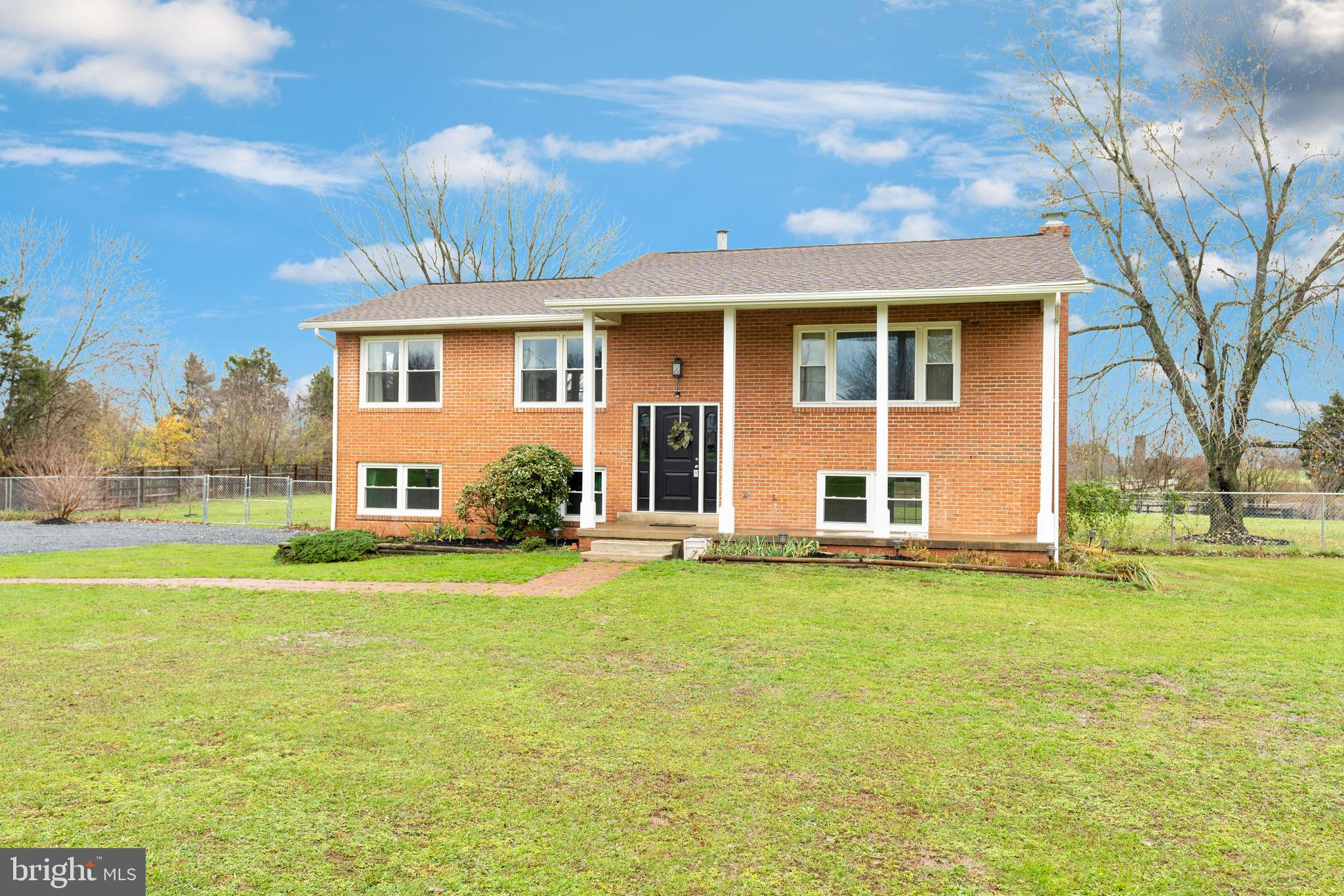 Gift-wrapped just in time!   Beautifully updated home situated on nearly 1.6 Acre Level Lot with Pas