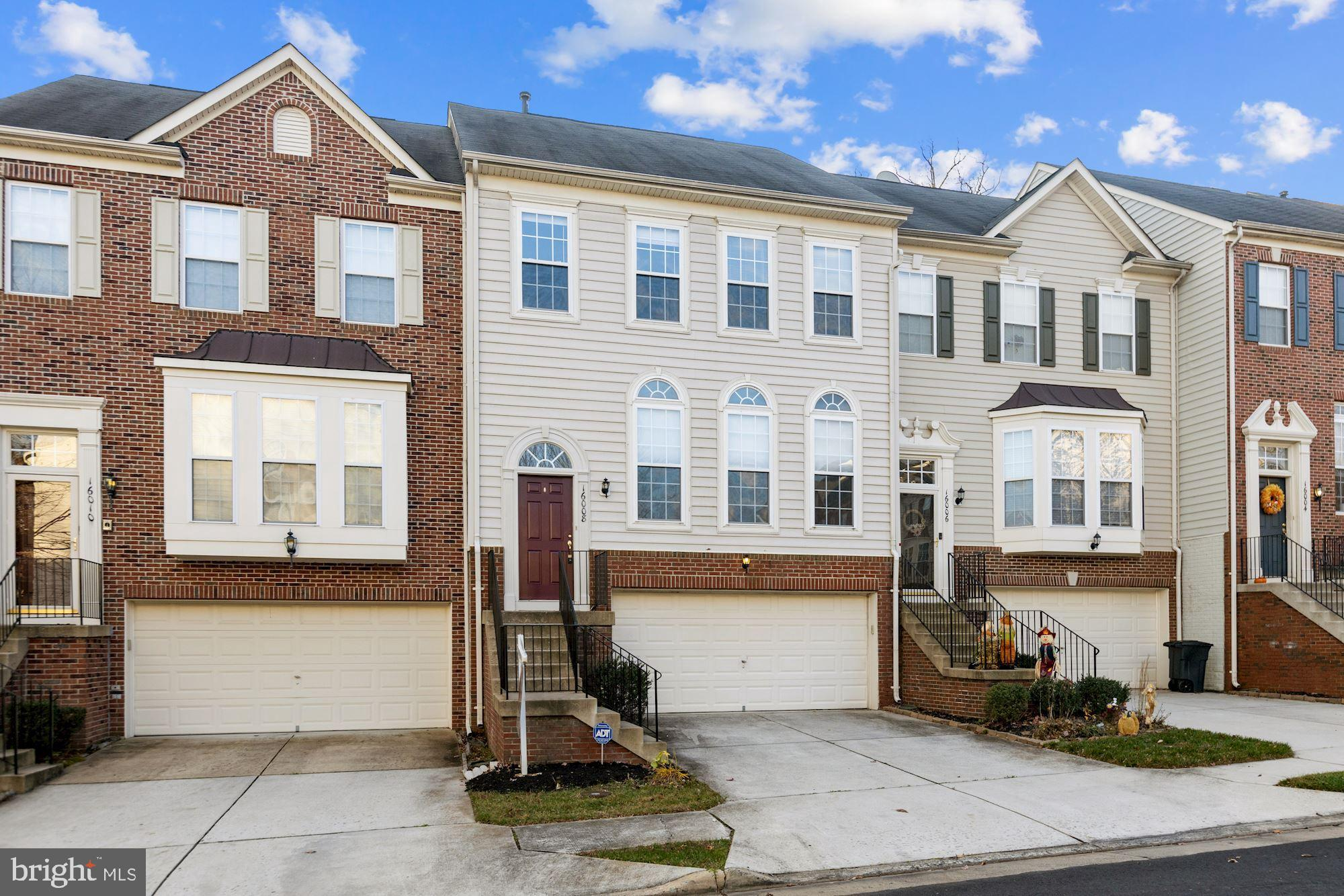 Luxury two car garage 3 level townhouse in Riverside Station. Enter into spacious open living room,