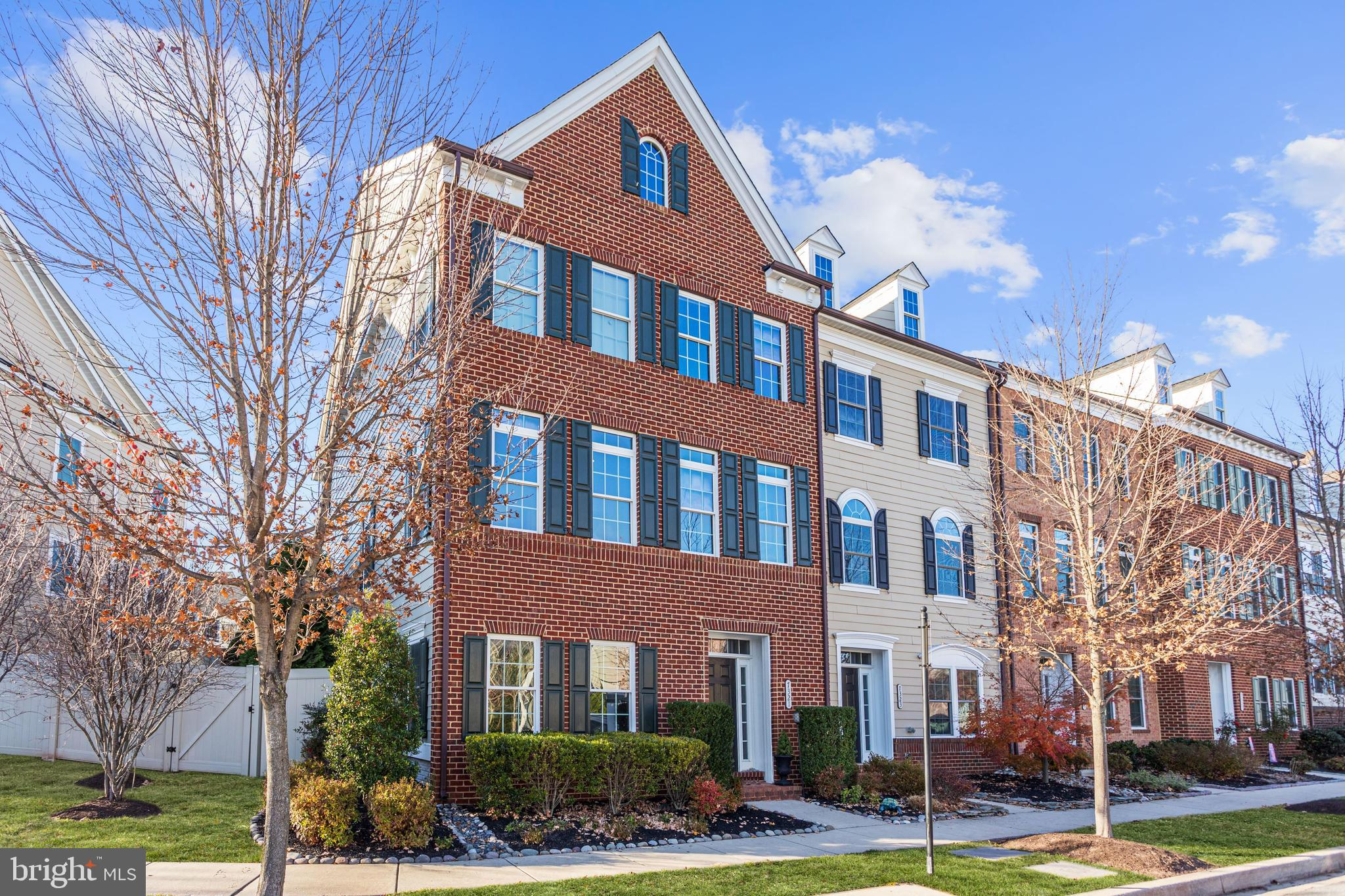 Gorgeous energy efficient end unit luxury townhome located in the desirable Maple Lawn community off