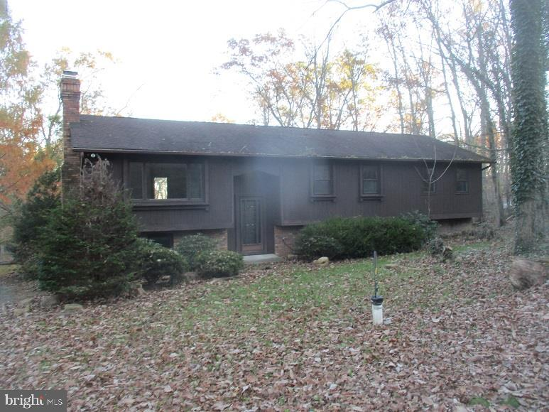 Great price on a bi-level located on a wooded lot of over an acre with four bedrooms and  two baths.