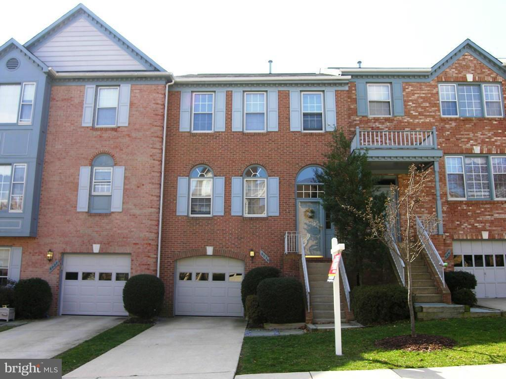 Welcome to 6026 Wescott Hills Way, an exquisite brick-front townhouse with a garage in Alexandria's