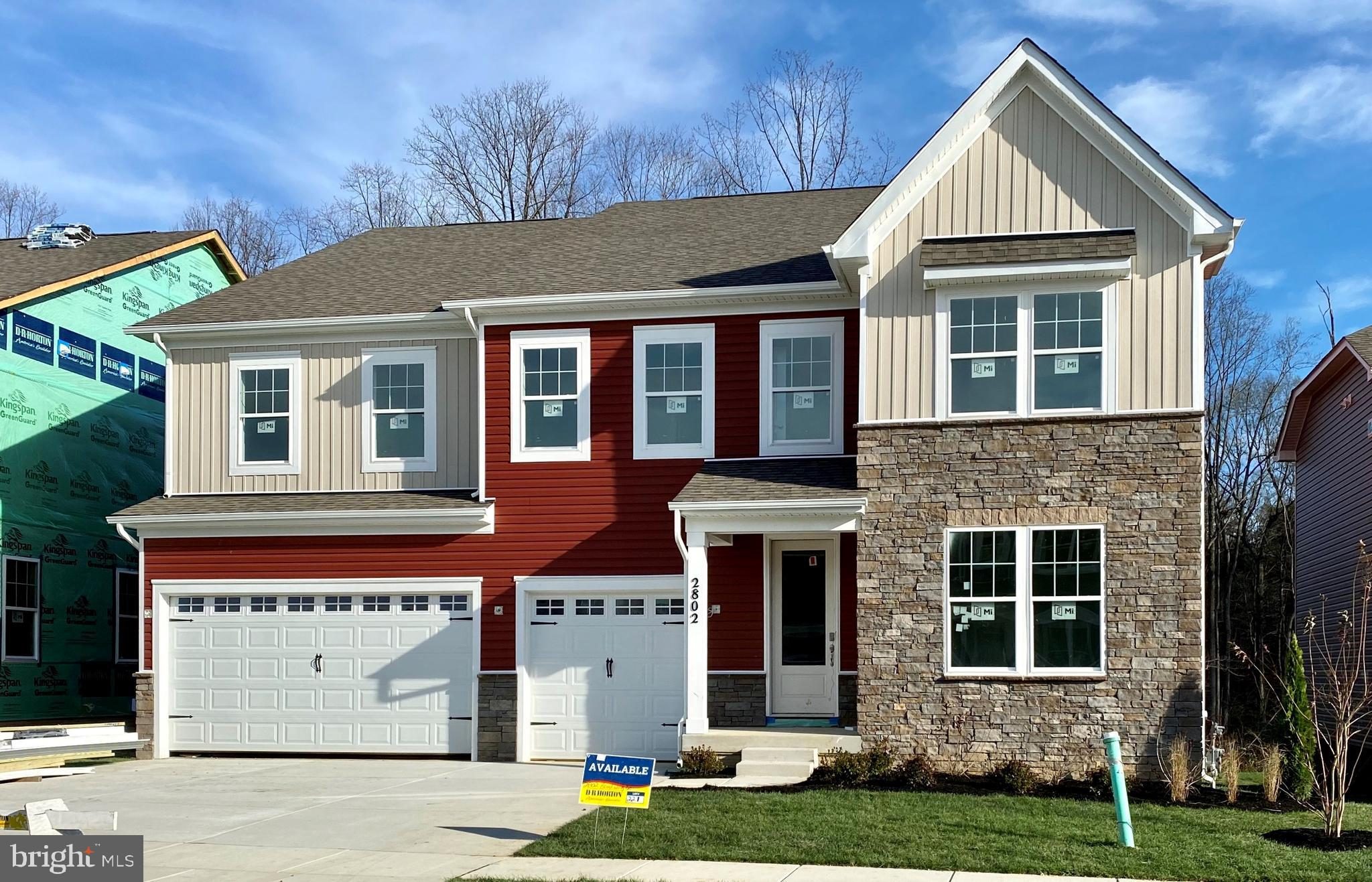 The Hampton's grand 2-story foyer will take your breath away.  The formal study will greet you at th