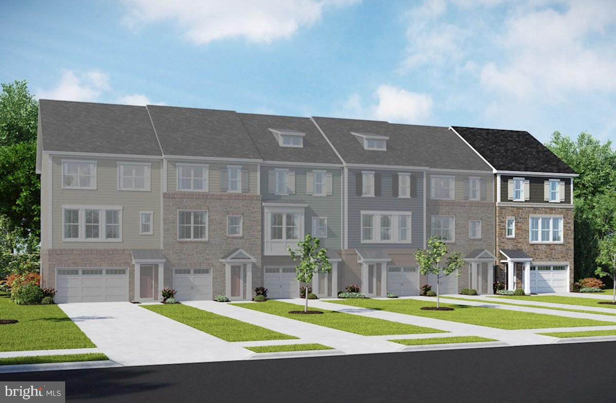 This to-be-built St. Michael  is a three story townhome featuring an entry level rec room, with a ce