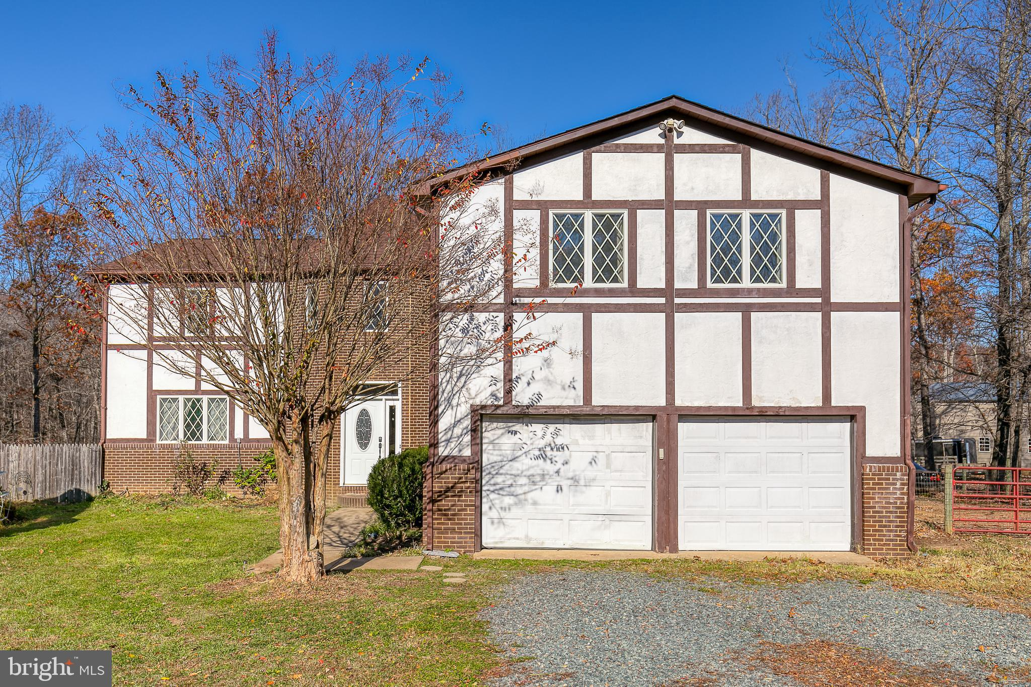Location with Acreage!!! Don't miss this charming French Country Tudor style home.  Over 3800 Square