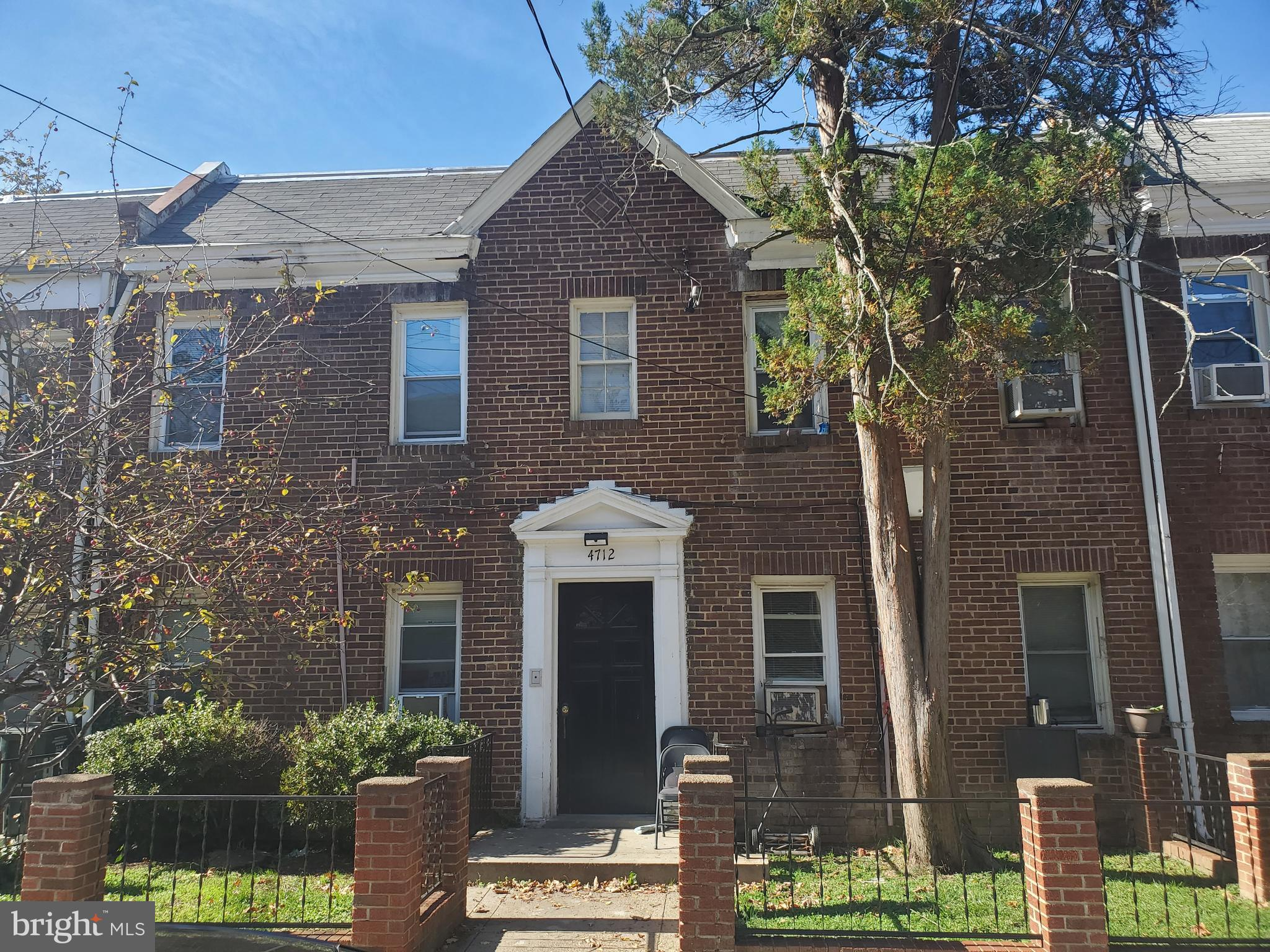 Occupied 4 unit building in Petworth consisting of  4 -1 bedroom  units with enclosed  porches. This