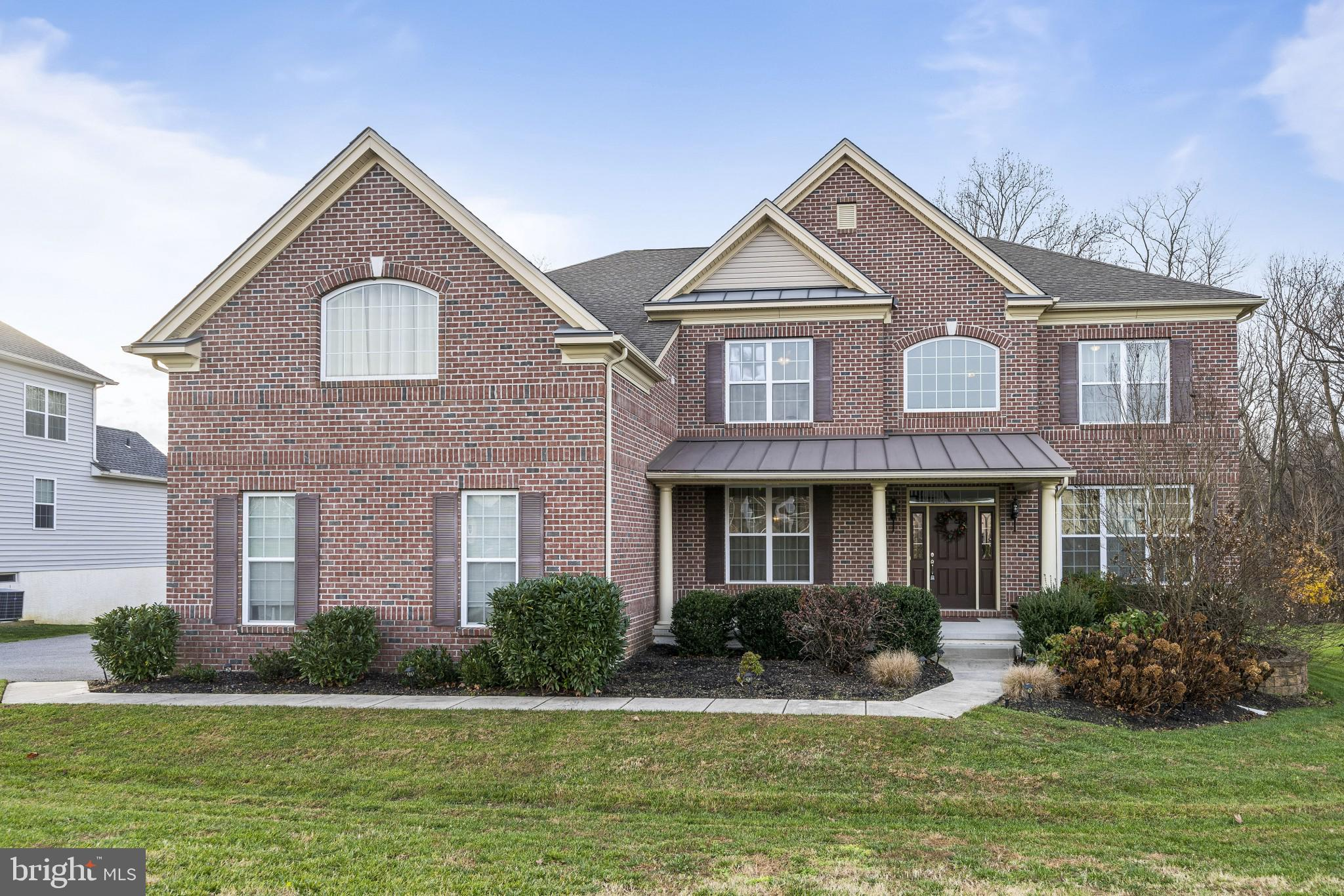 Welcome Home to 1437 Olmsted Drive in the highly desirable community of Red Lion Chase. This brick f