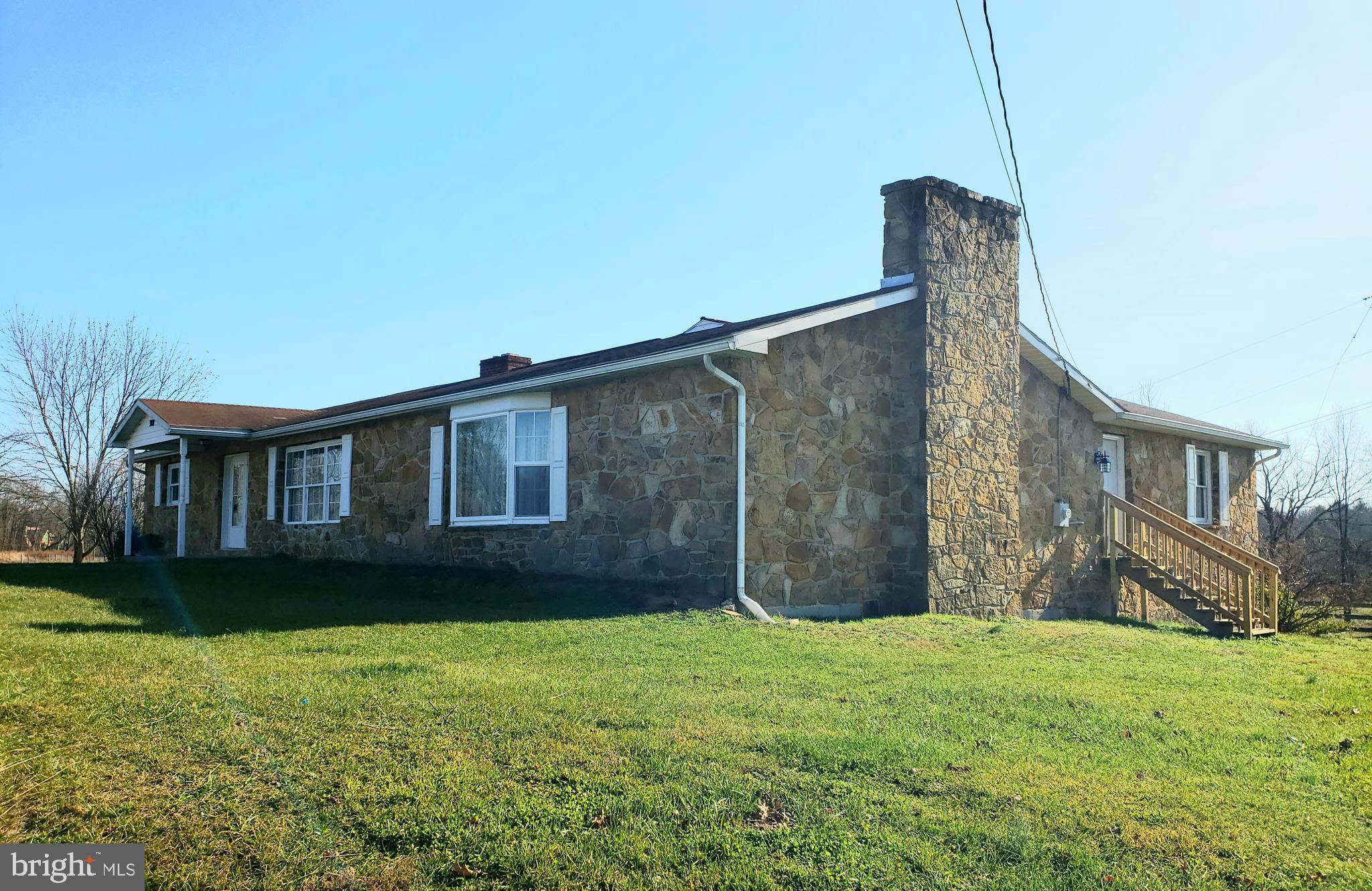 One of a kind...Local Stone from Tomahawk covers this sprawling 3 bedroom rancher. Large open Kitche