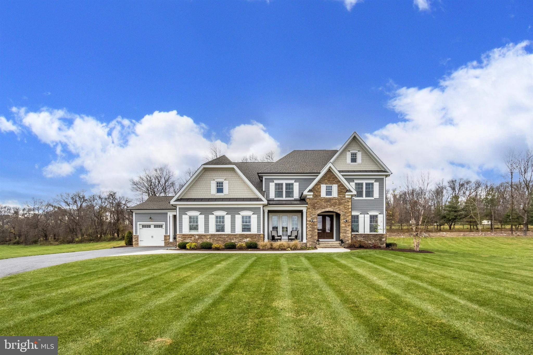 Beautiful home in the sought after Manor at Holly Hills community. This amazing home is situated on