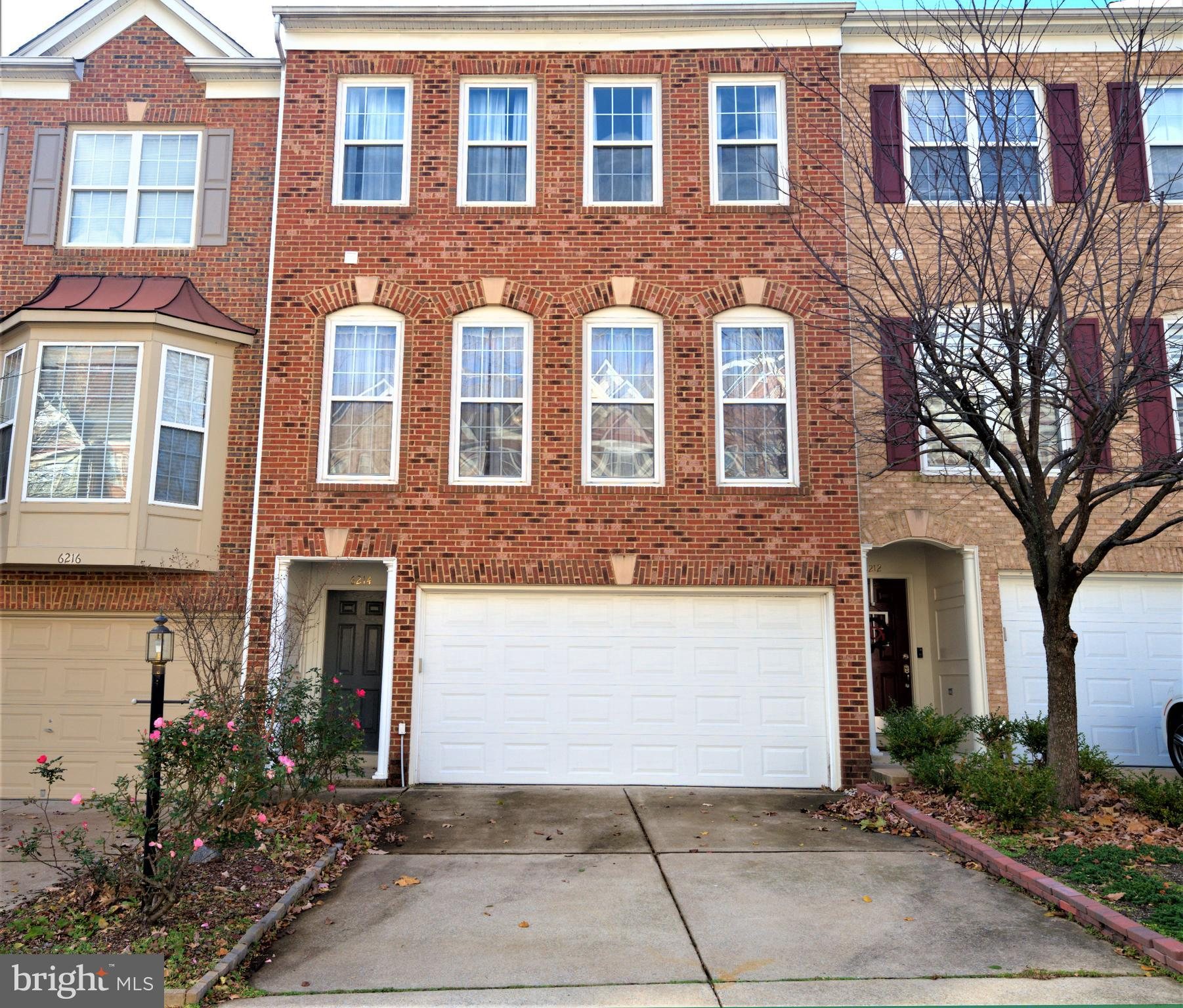 3-level Townhouse with 2-car garage, colonial style with crown molding, shining natural oak hardwood