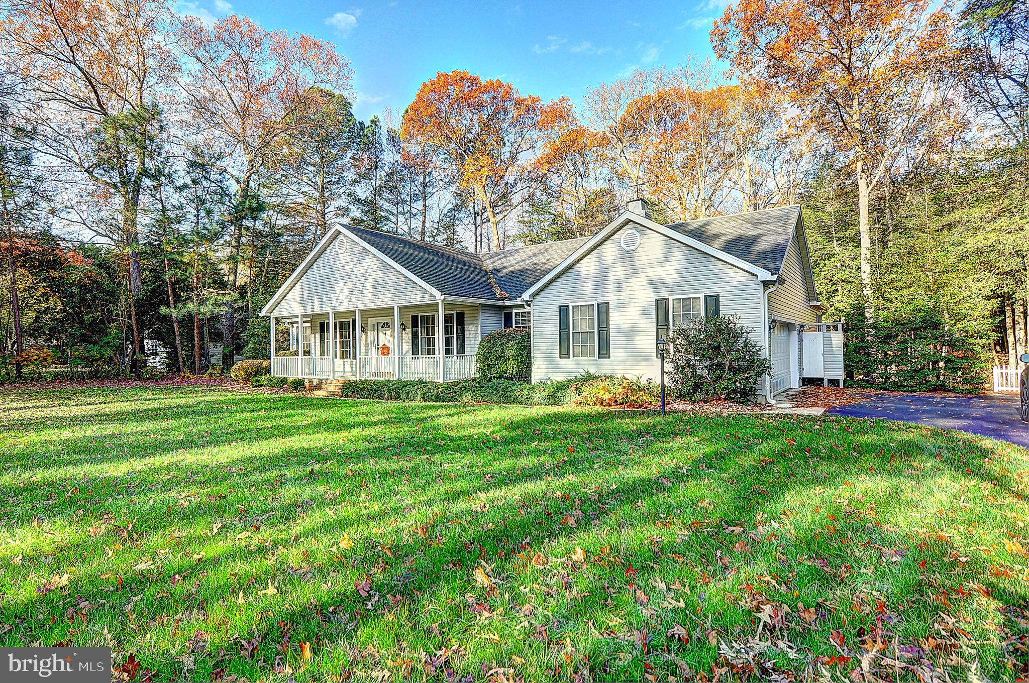 Well maintained ranch home nestled in a highly desired private, wooded setting in the most convenien