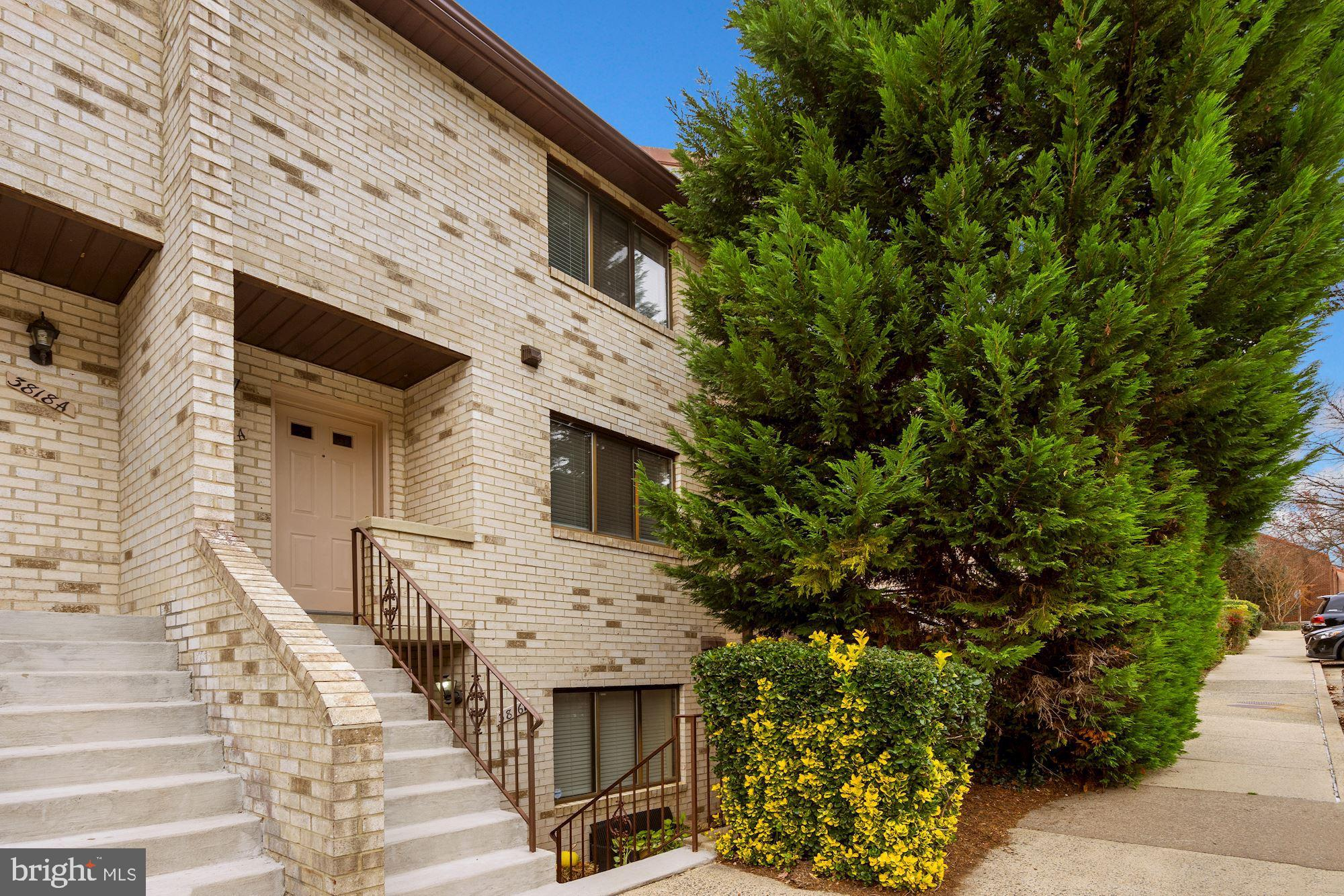 Newly  updated two level condo in much sought-after community.     Foyer with beautiful exposed bric