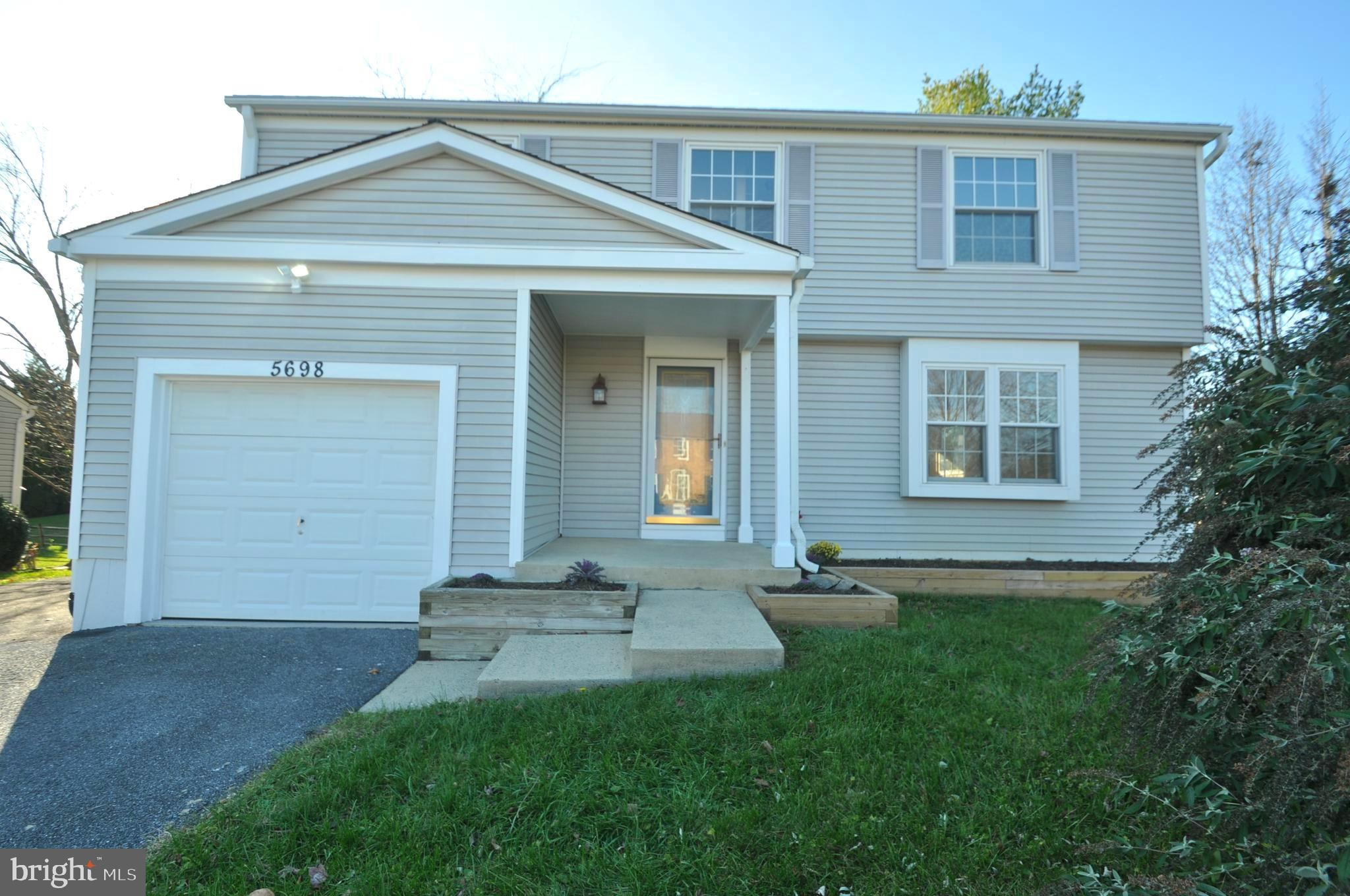 1ST OPEN OPEN HOUSE SAT 12/5 & SUN 12/6 1:30-3:30.  BRIGHT 3 LEVEL GARAGE HOME  (4 windows added to