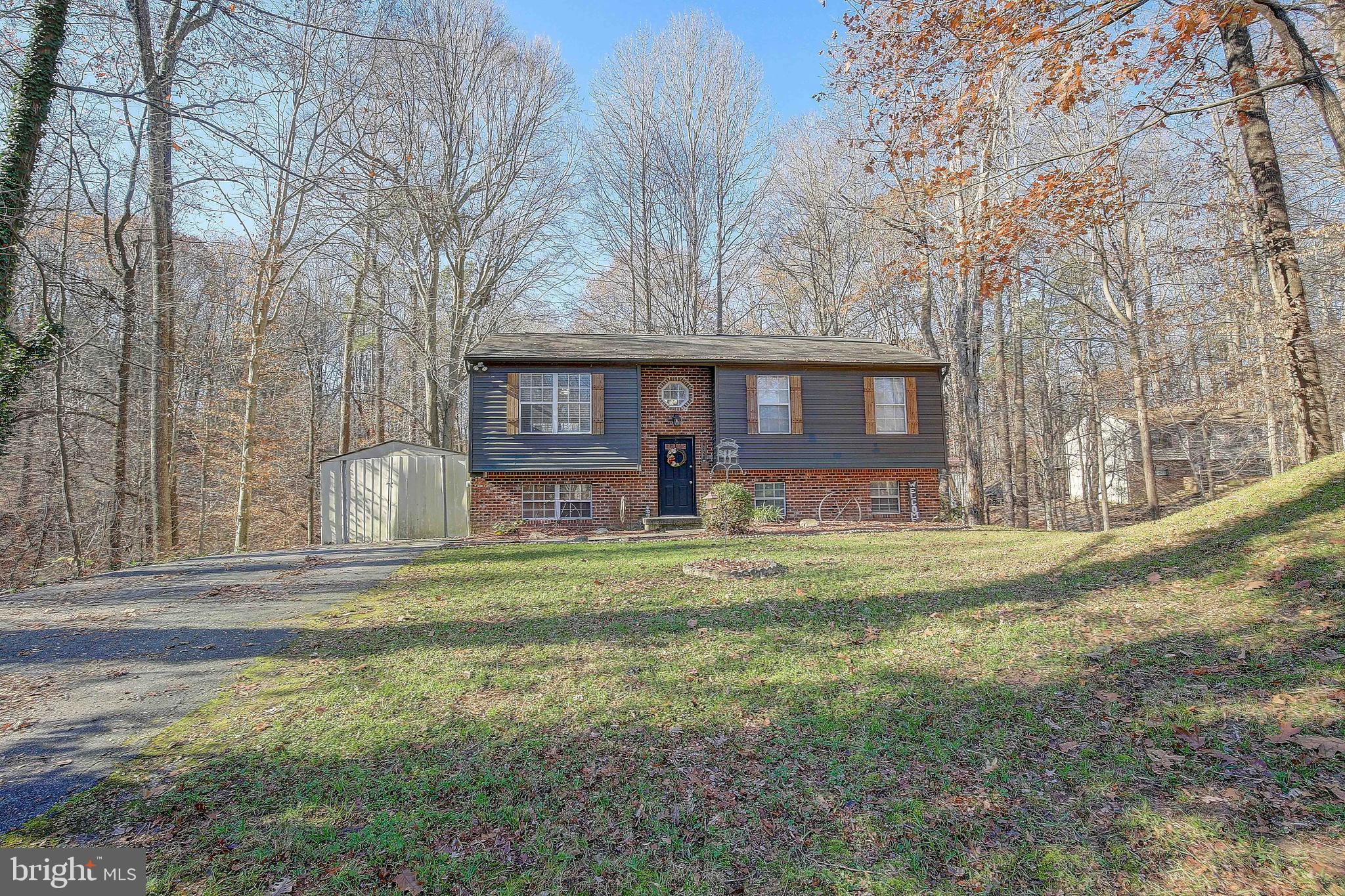 Perfect starter home nestled along the privacy of the wooded property.   Open concept with a complet