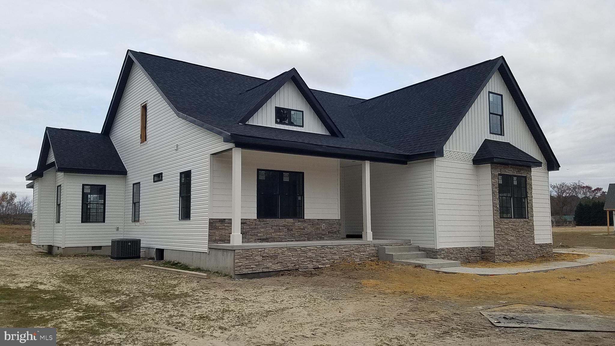 This new construction will DAZZLE you with it's open floor plan , vaulted ceiling, and fireplace in