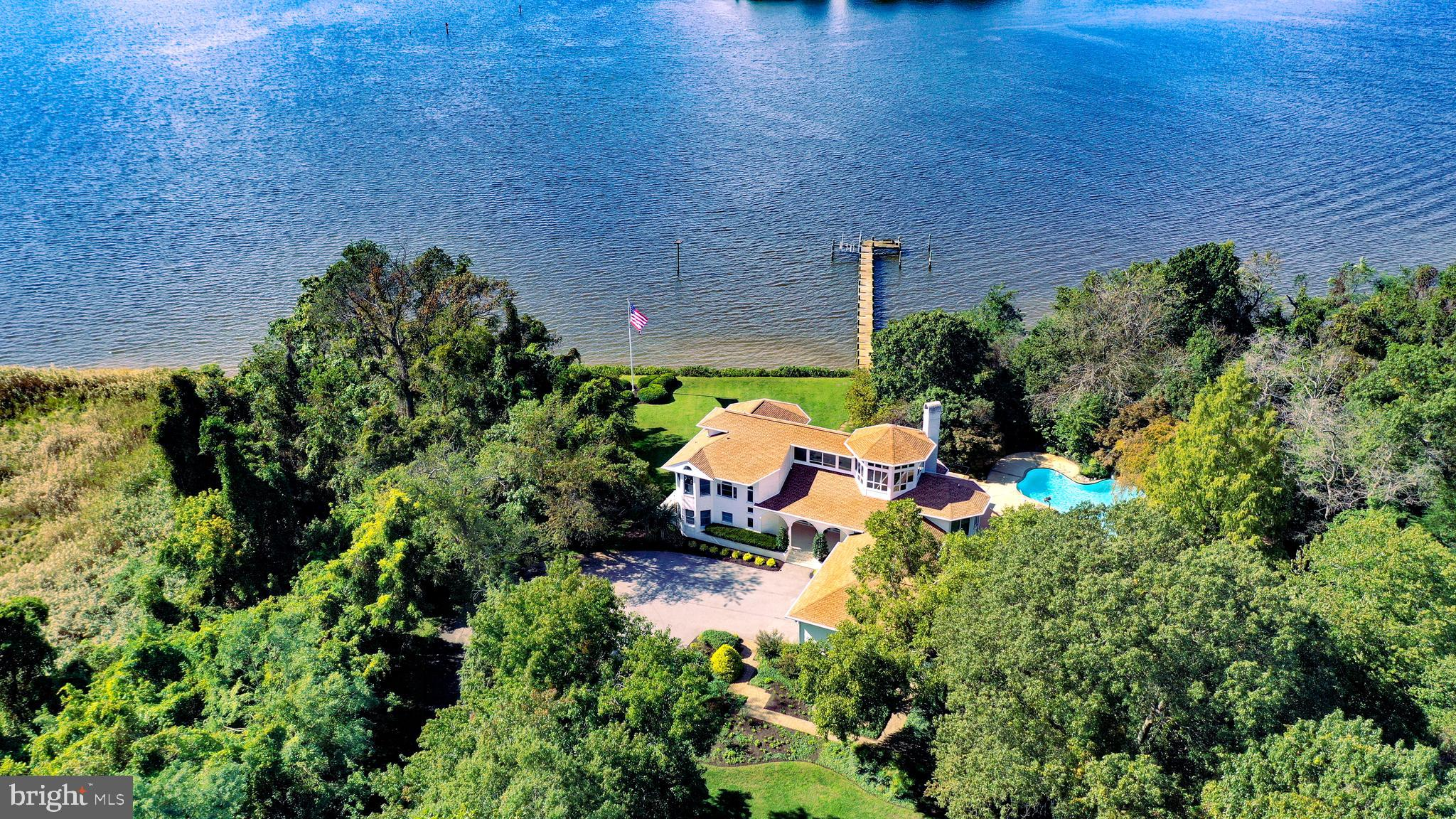 Extraordinary Waterfront Property in Prestigious Bodkin Pointe.  Never offered before and built by the developer of Bodkin Pointe!  Don't miss this the opportunity to have your very own luxury Escape! Private gated Driveway to 10 + Acres of resort style living with amazing elevated Water views from Main Residence. Waterfront Owner's Suite on private floor with elevator accessible, sitting room and balcony.  Third Floor Glass lookout loft  with 360 degree views, balcony and wet bar for waterfront happy Hours. Heated pool with waterslide, waterfall, hot tub & attached pool house/apartment.  3 Story Ceilings height and unobstructed views.  630' of Riparian Waterfrontage, 184 ft. Private pier on protected water with boat lift.  Contemporary floorplan with Stunning Entrance, 2 story kitchen & great room.  Detached Guest House with additional 4 CAR garage &  2K+ square feet of living and entertainment space overlooking professional volleyball courts on premises. Private oasis ready for you to have the time of your life!  Copy and paste this link to view interactive floorplan and 3D Tour.  https://mls.TruPlace.com/property/620/94072/