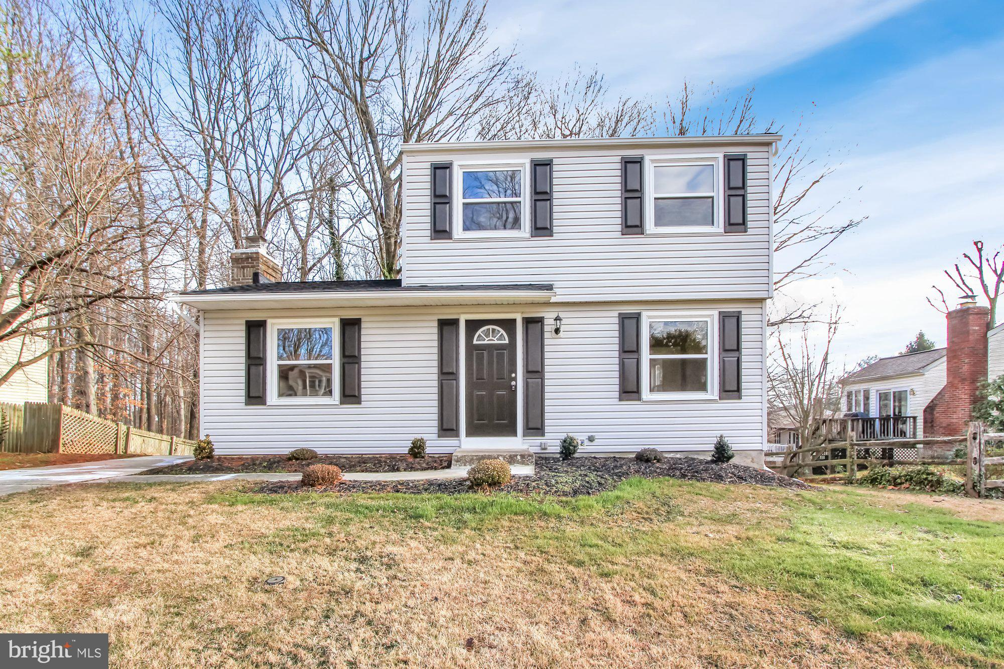 Beautifully Renovated Colonial Backing to Trees & Common Area!  Main Level Entrance Foyer is open to