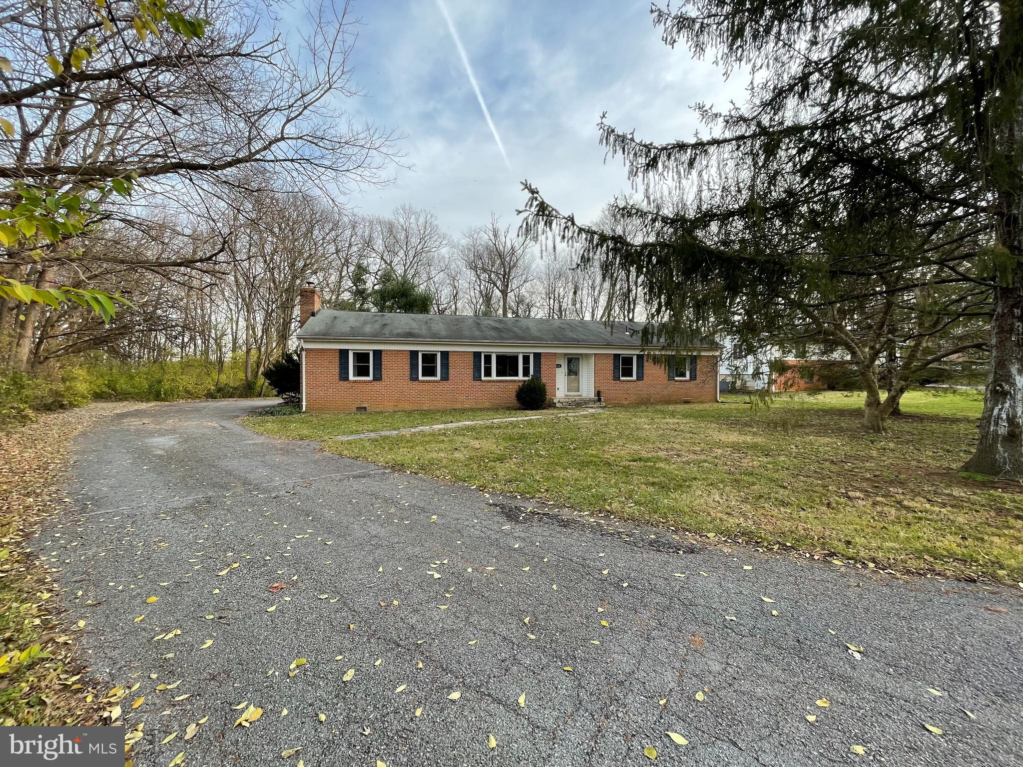 Charming, well-maintained brick home at the end of a non-thoroughfare street! Upon entering, you are